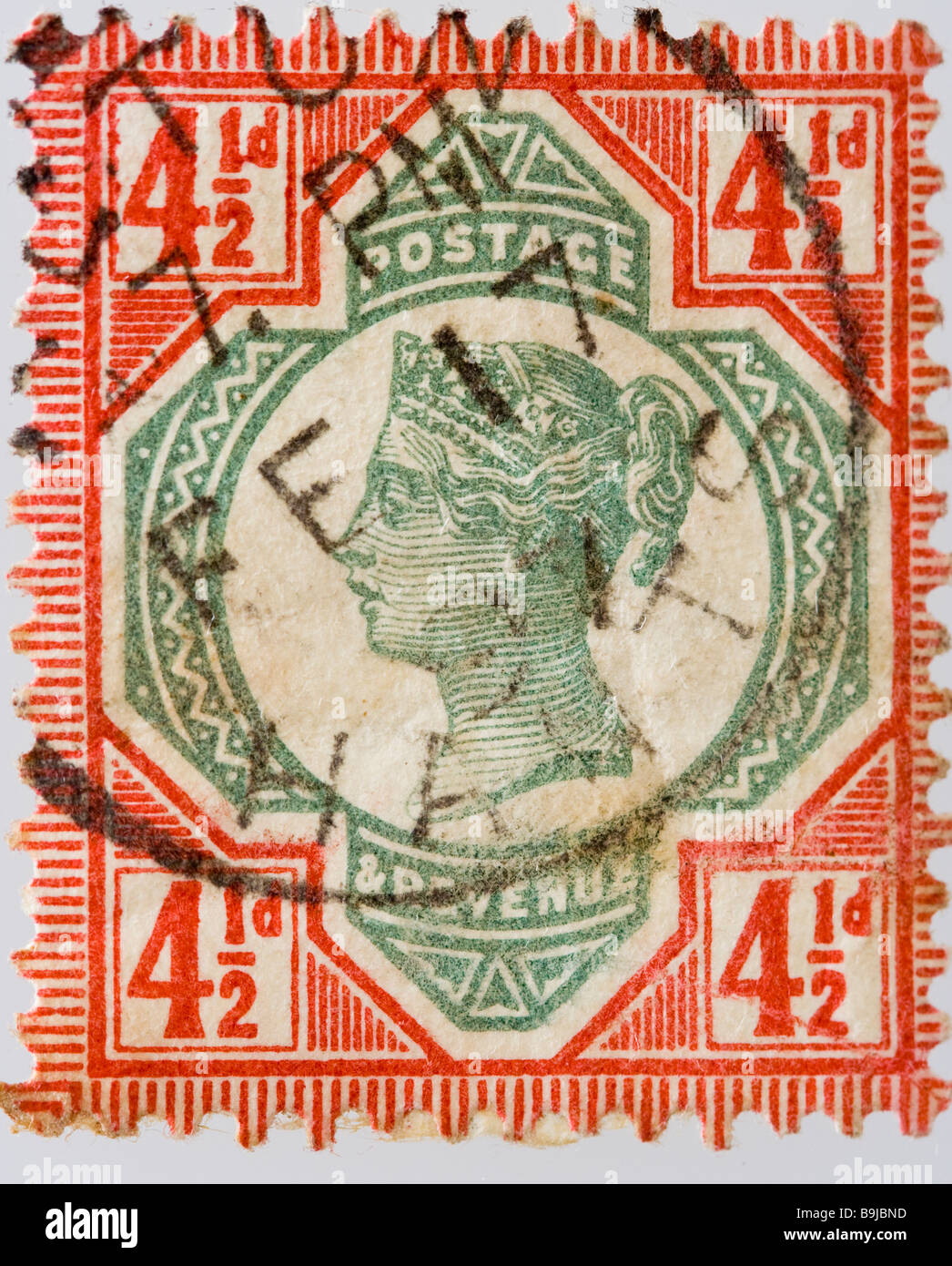 British Victorian four and half pence postage stamp 1887-1900 SG 206, bright red and green, franked, used - Stock Image