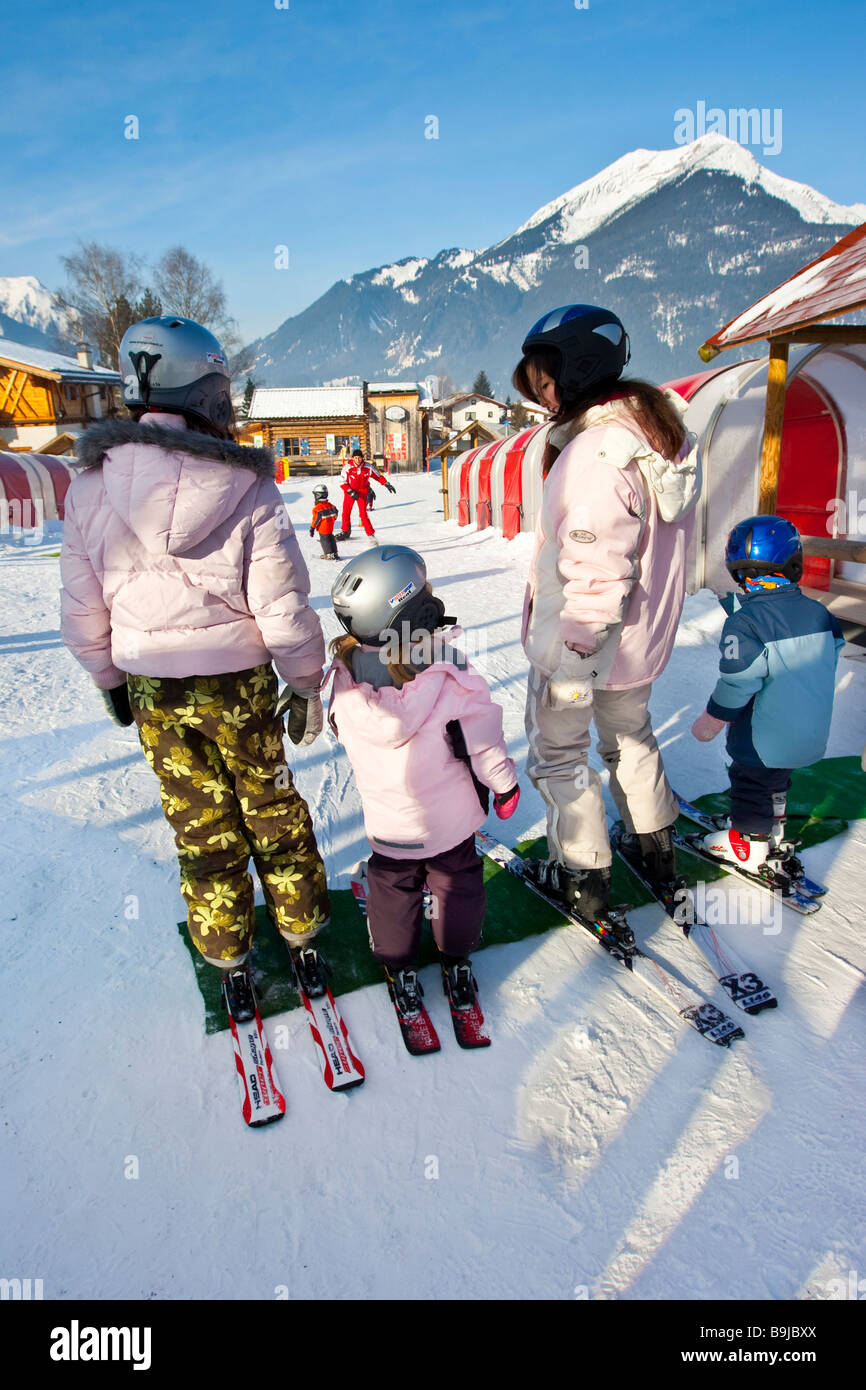 Children being taught by a ski instructor in a beginners course in a ski school, Ehrwald, Tyrol, Austria, Europe - Stock Image