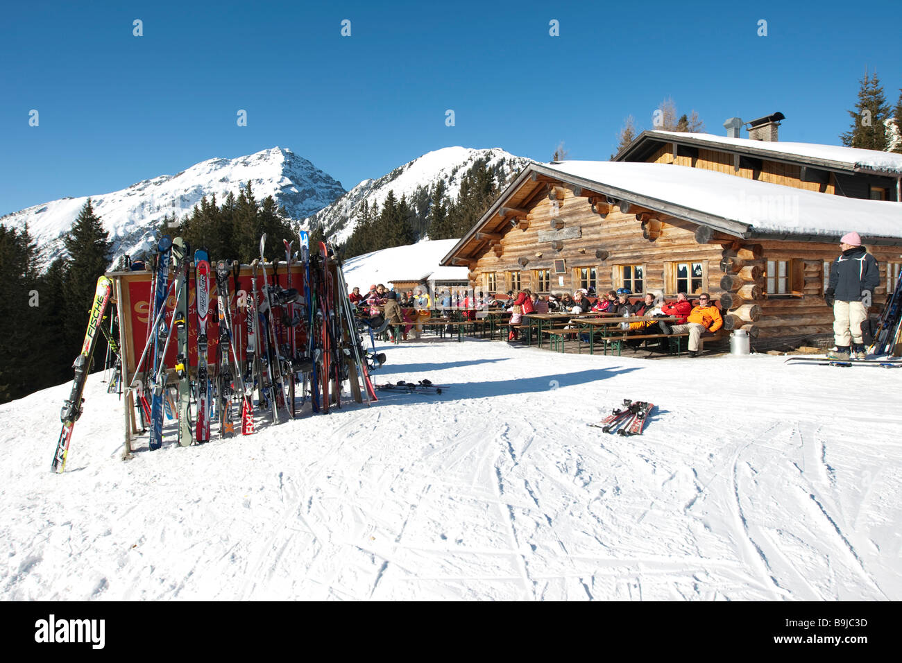Skis standing on the Heitwanger Hochalm mountain pasture, Bichelbach, Tyrol, Austria, Europe Stock Photo