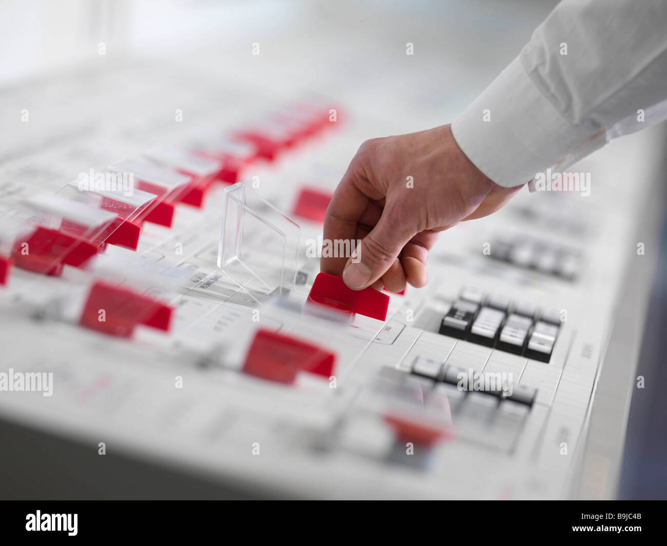 Operator turning red switch - Stock Image
