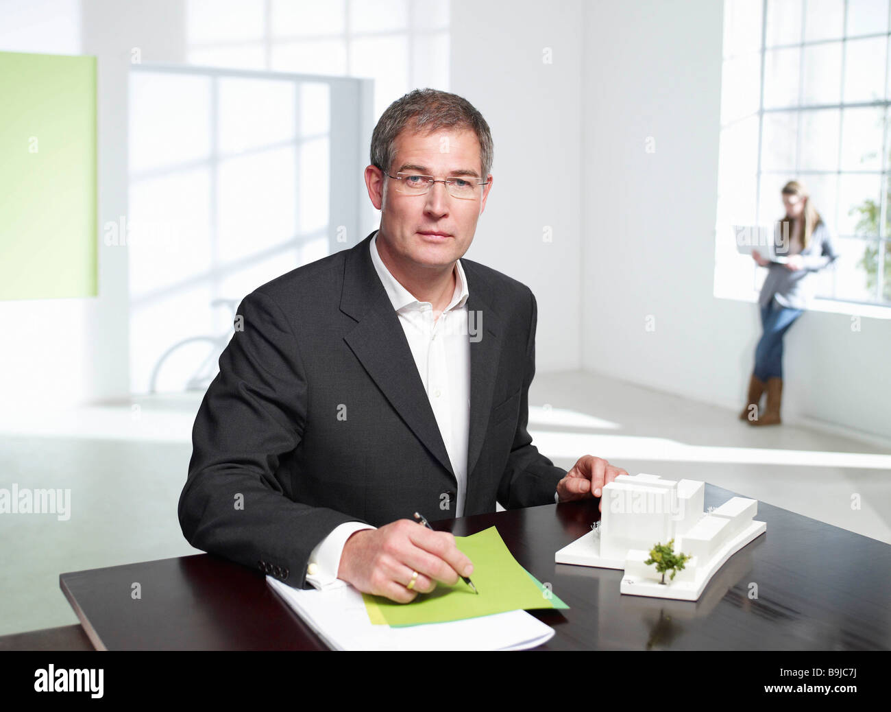 Architect at work in loft office - Stock Image