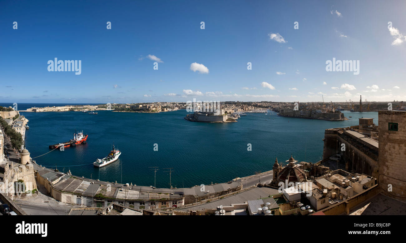 View from Valletta of Grand Harbour, from left: Rinella, Kalkara, Fort St Angelo and Senglea, in the back the harbour - Stock Image