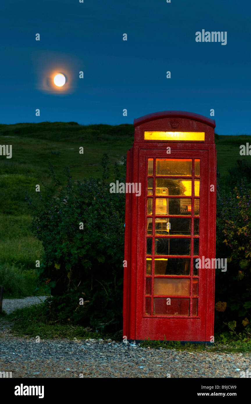 English phone box and full moon in South England, Great Britain, Europe - Stock Image