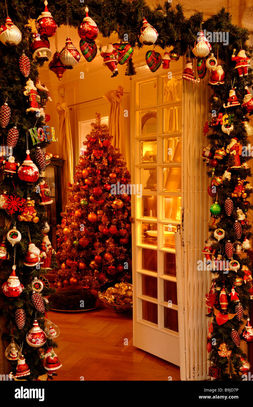 Christmas decoration, entrance in Christmas adornment with view to decorated Christmas tree in Villa Ambiente, Nuremberg, - Stock Image
