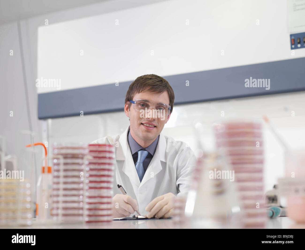 Laboratory technician at work - Stock Image