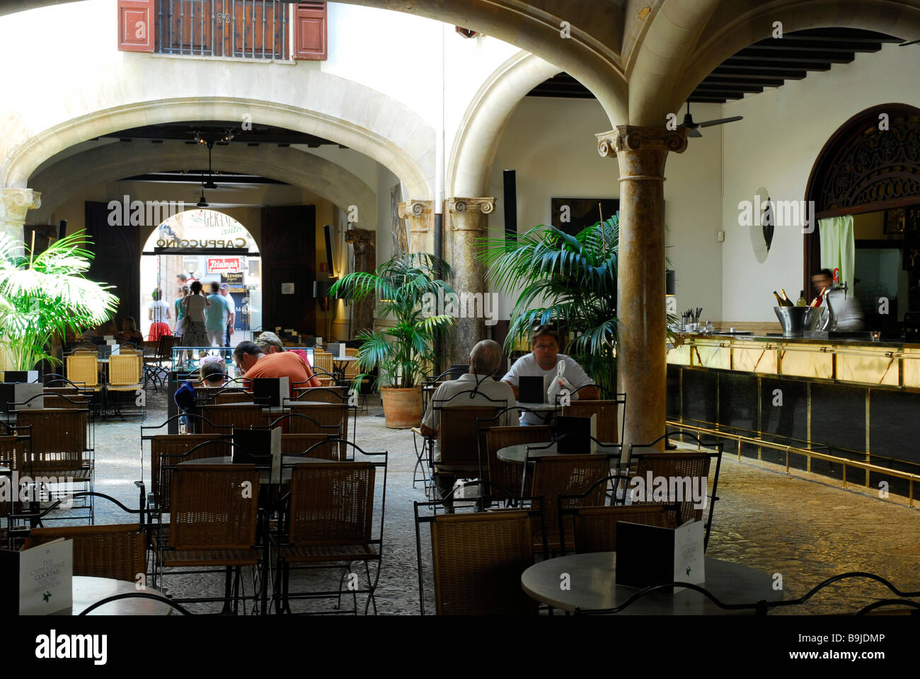 Grand Cafe Cappuccino in a former city palace, inner court, Patio in the Sant Miquel quarter, historic city centre, - Stock Image