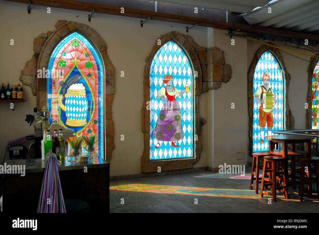 Kitschy windows with Bavarian motives in Ballermann discotheque at the Platja de Palma, Mallorca, Balearic Islands, - Stock Image