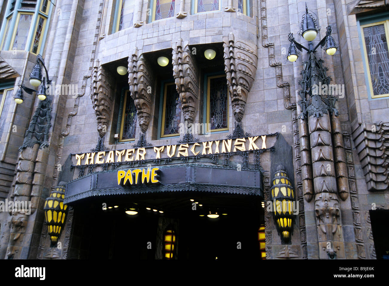 Tuschinski Theatre, Pathe Cinemas, cinema, detail of the facade with lit-up entrance in the Reguliersbreestraat, - Stock Image