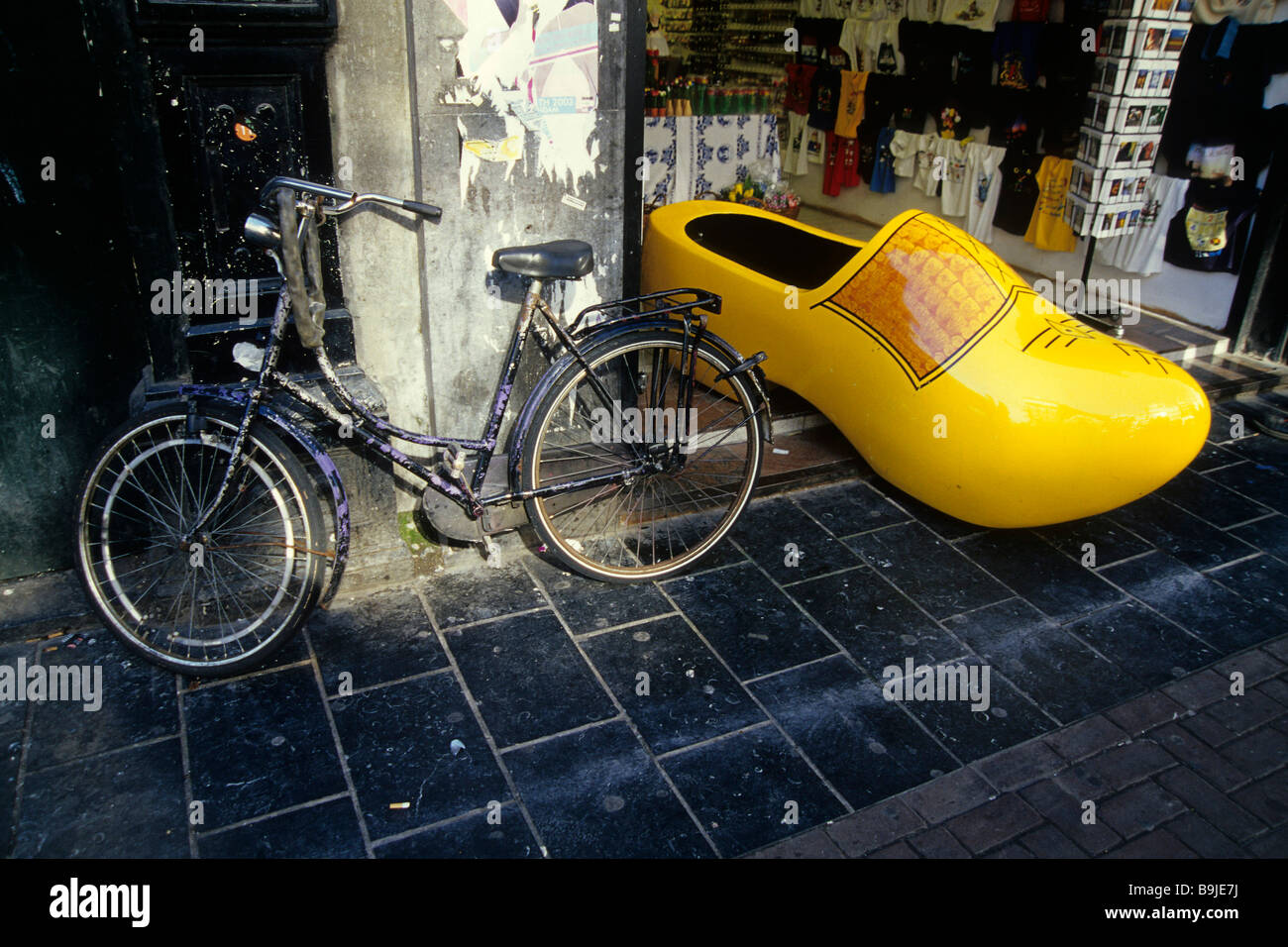 Souvenir shop, big wooden shoe, favoured souvenir, bike in the city centre, Amsterdam, North Holland, Netherlands, - Stock Image