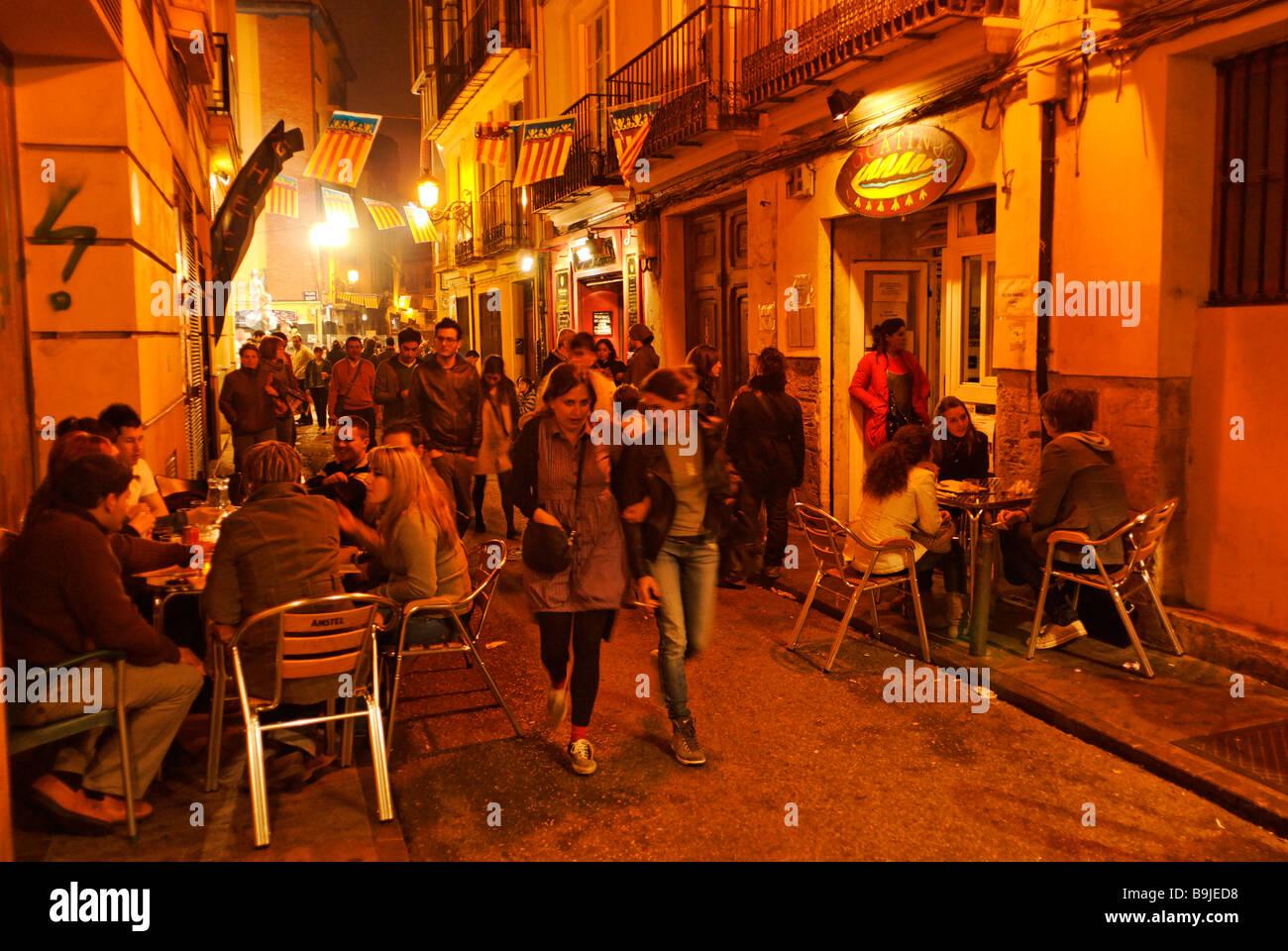 Busy street scene in the old barrio El Carmen during Las Fallas festival historical city centre of Valencia Spain - Stock Image