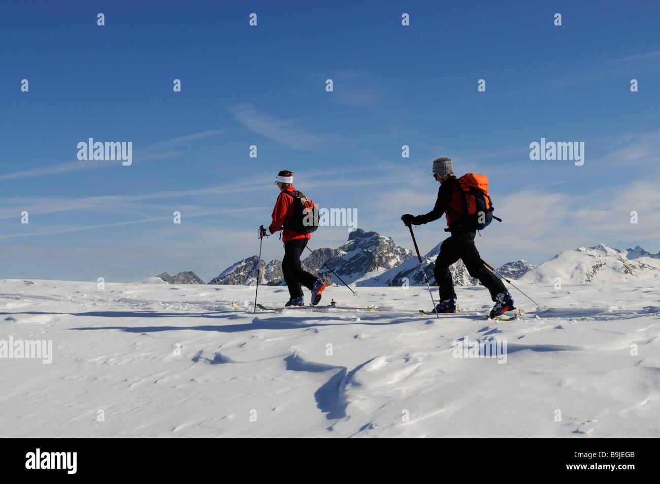 Ski alpinists on Parwengsattel, Sankt Stephan, Zweisimmen, Saanenland, Western Alps, Bernese Oberland, Switzerland, - Stock Image