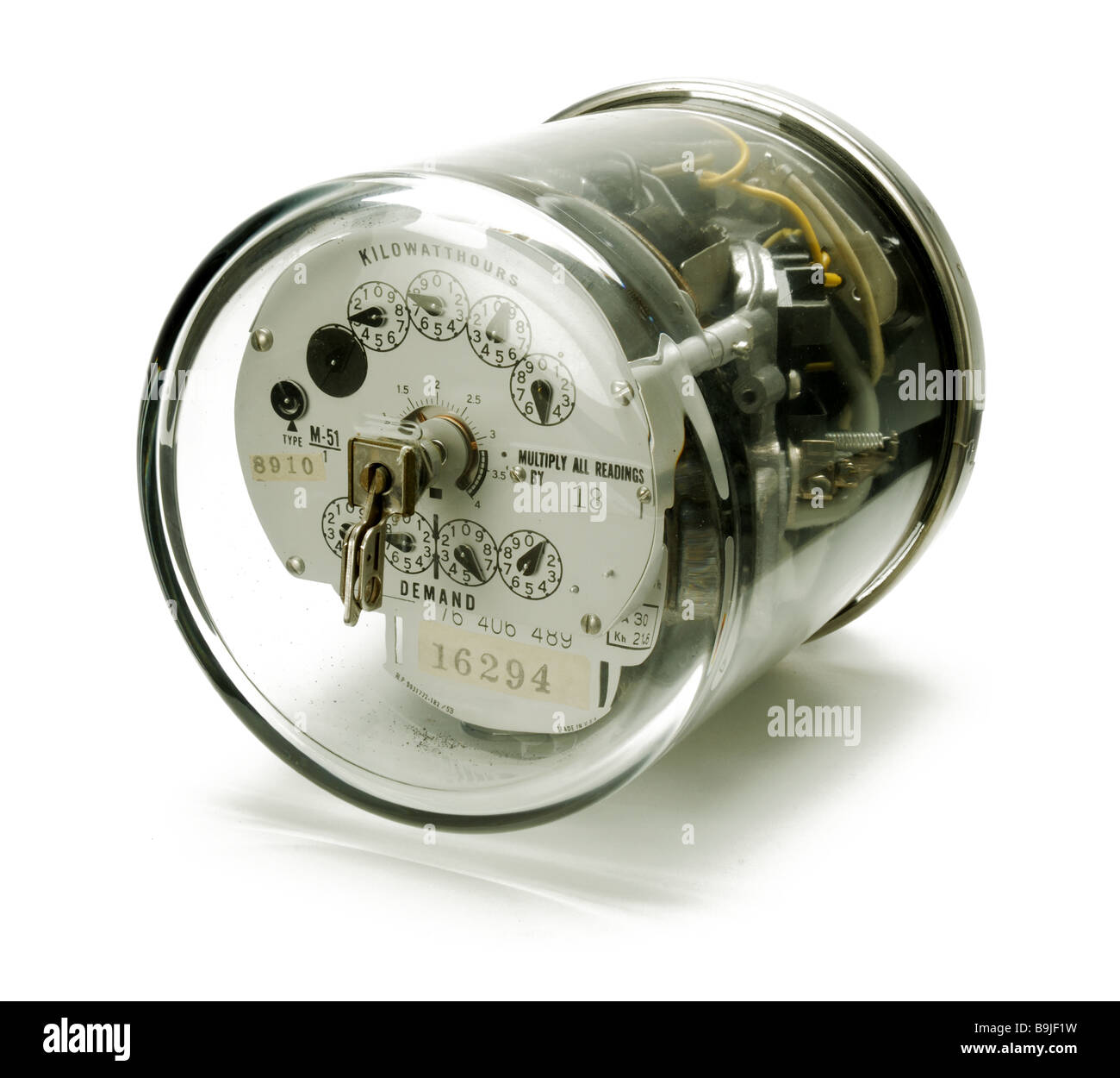 An electrical power meter on it's side - Stock Image