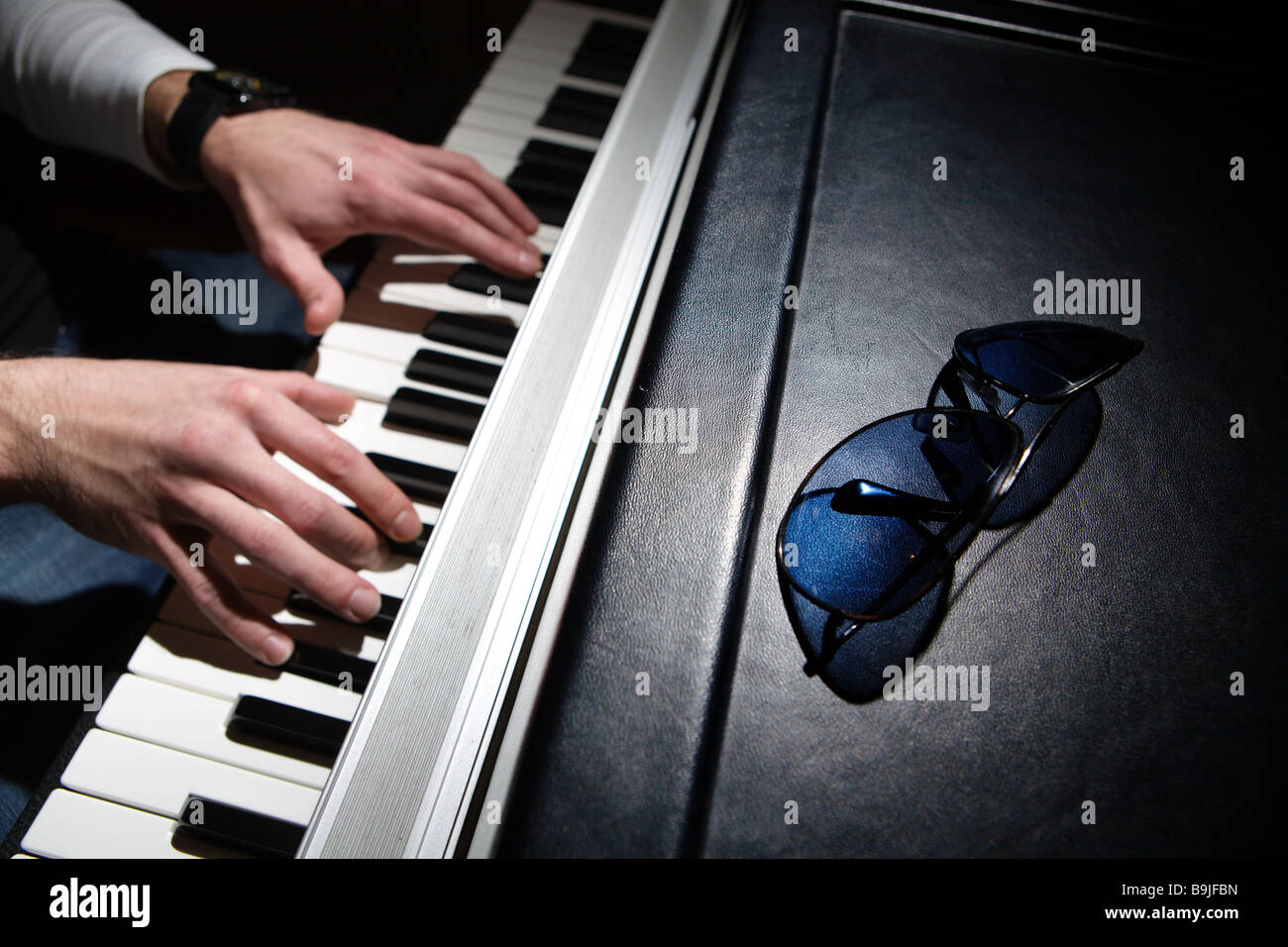 Pianist playing on electric piano - Stock Image