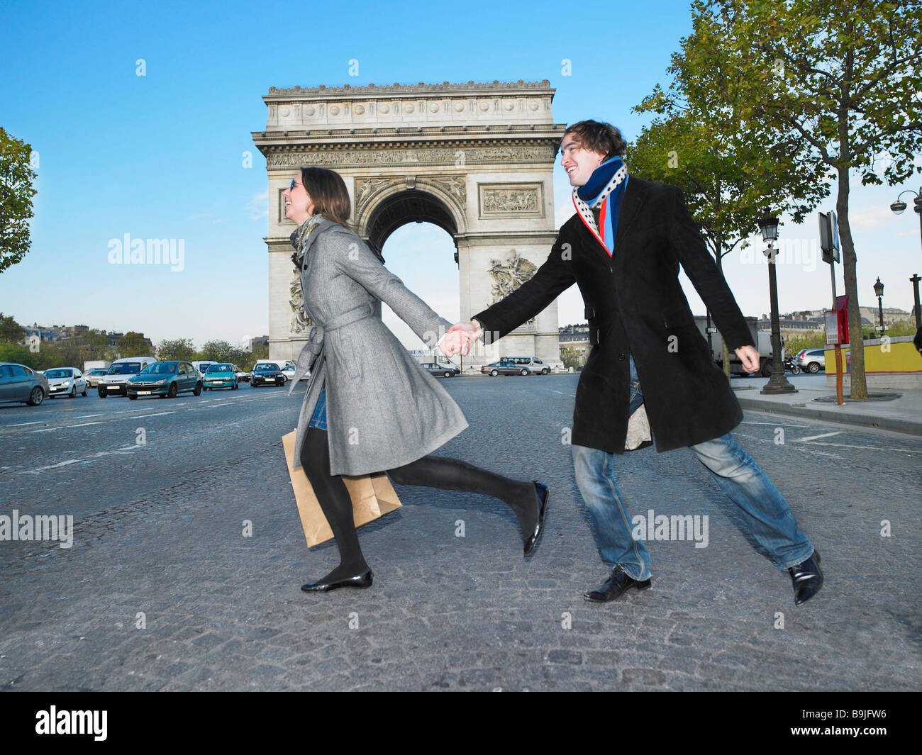 Couple walking on Champs Elysees - Stock Image