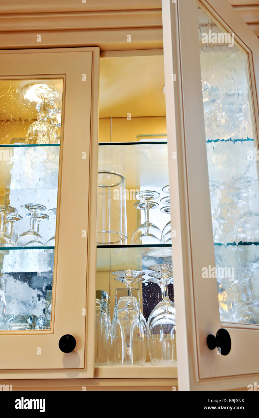 Kitchen Cabinet Close Up With Glass Shelves And Glasses Stock Photo