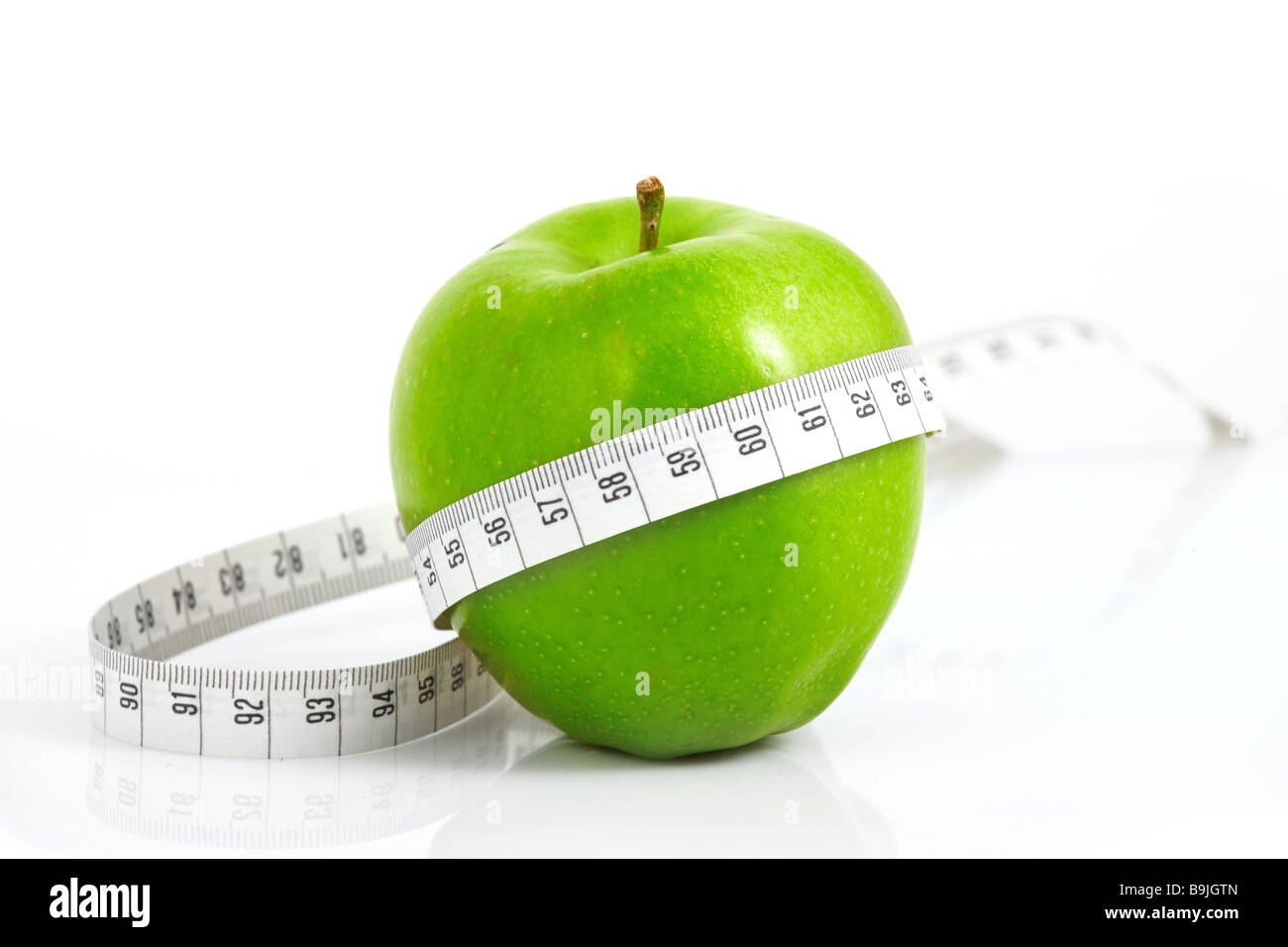 Green apples measured the meter sports apples - Stock Image