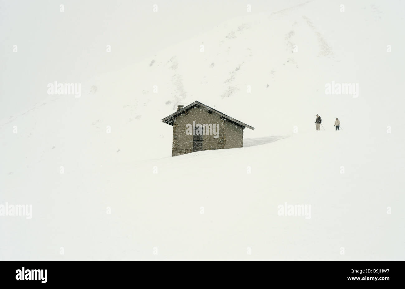 Mountain hut in snow - Stock Image