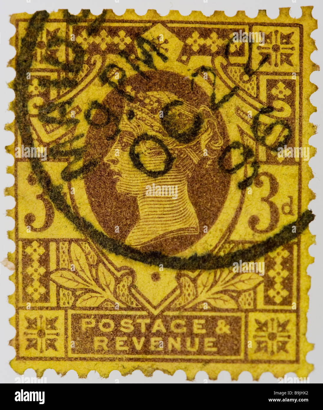British Victorian 3d postage stamp 1887-1900 SG 202-204, deep yellow, used, franked - Stock Image