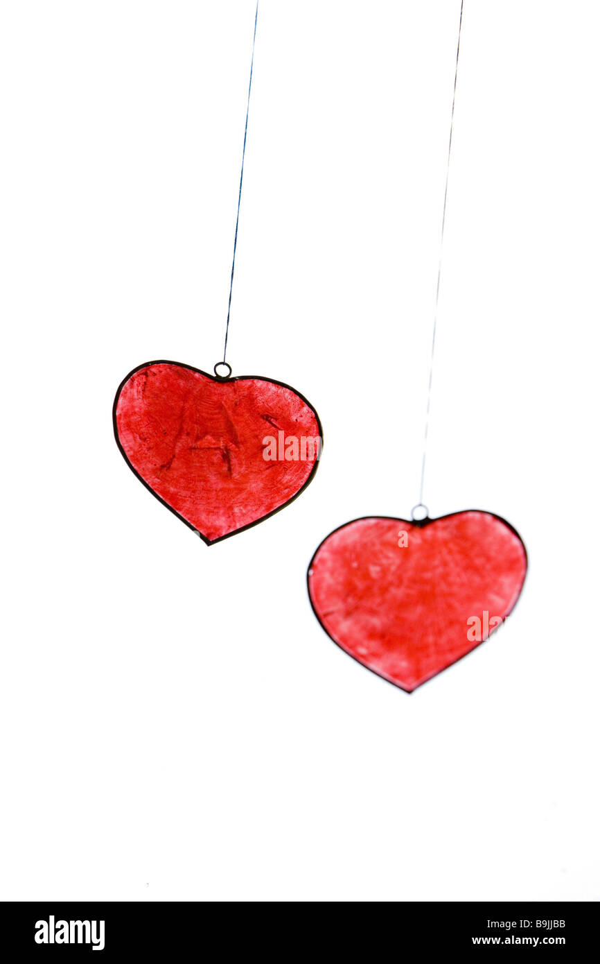 Duckies hangers  Hangers doubly emotion form clipping path feelings gift marriages heart duckies heart-form delightful - Stock Image