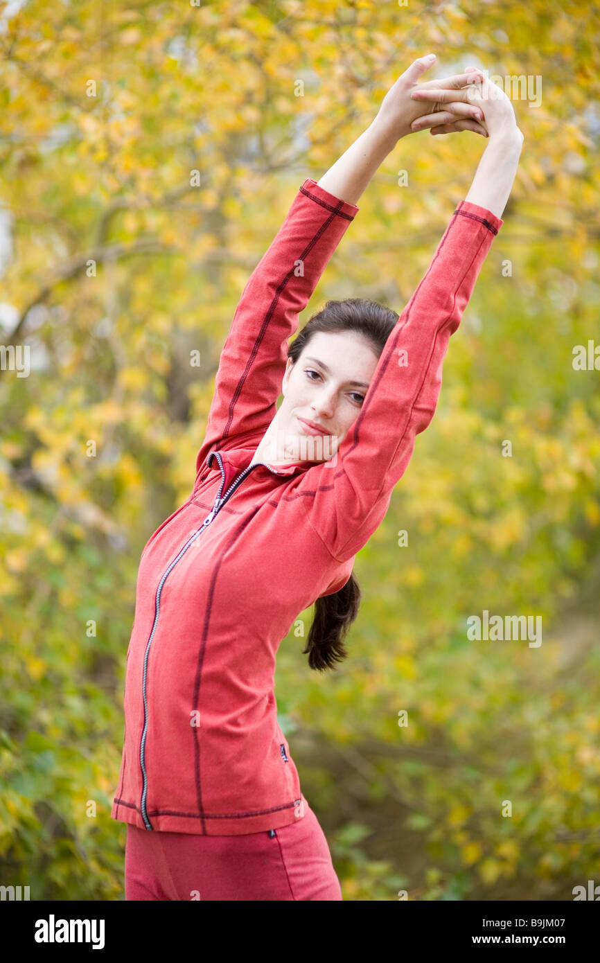 Young woman stretching - Stock Image