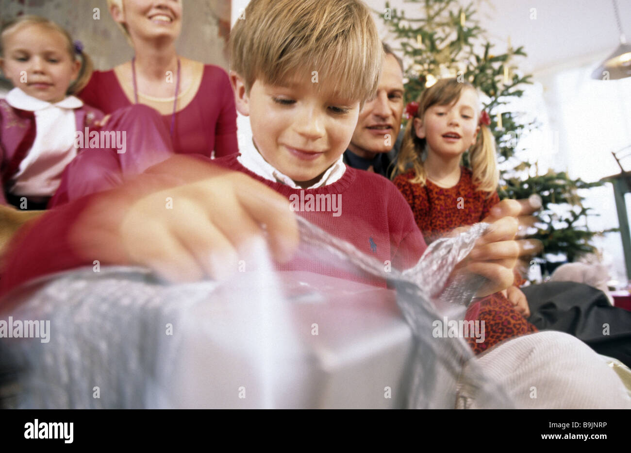 christmas family gift-giving cheerfully series people parents pair ...