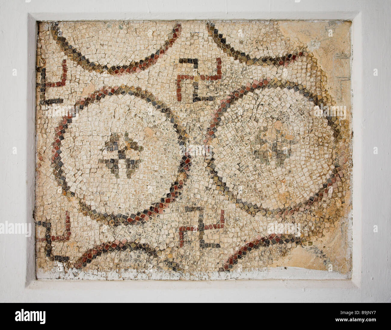 Mosaic showing swastika used as a design element at the Archaeological Museum, Sousse, Tunisia. Sousse, Tunisia. - Stock Image