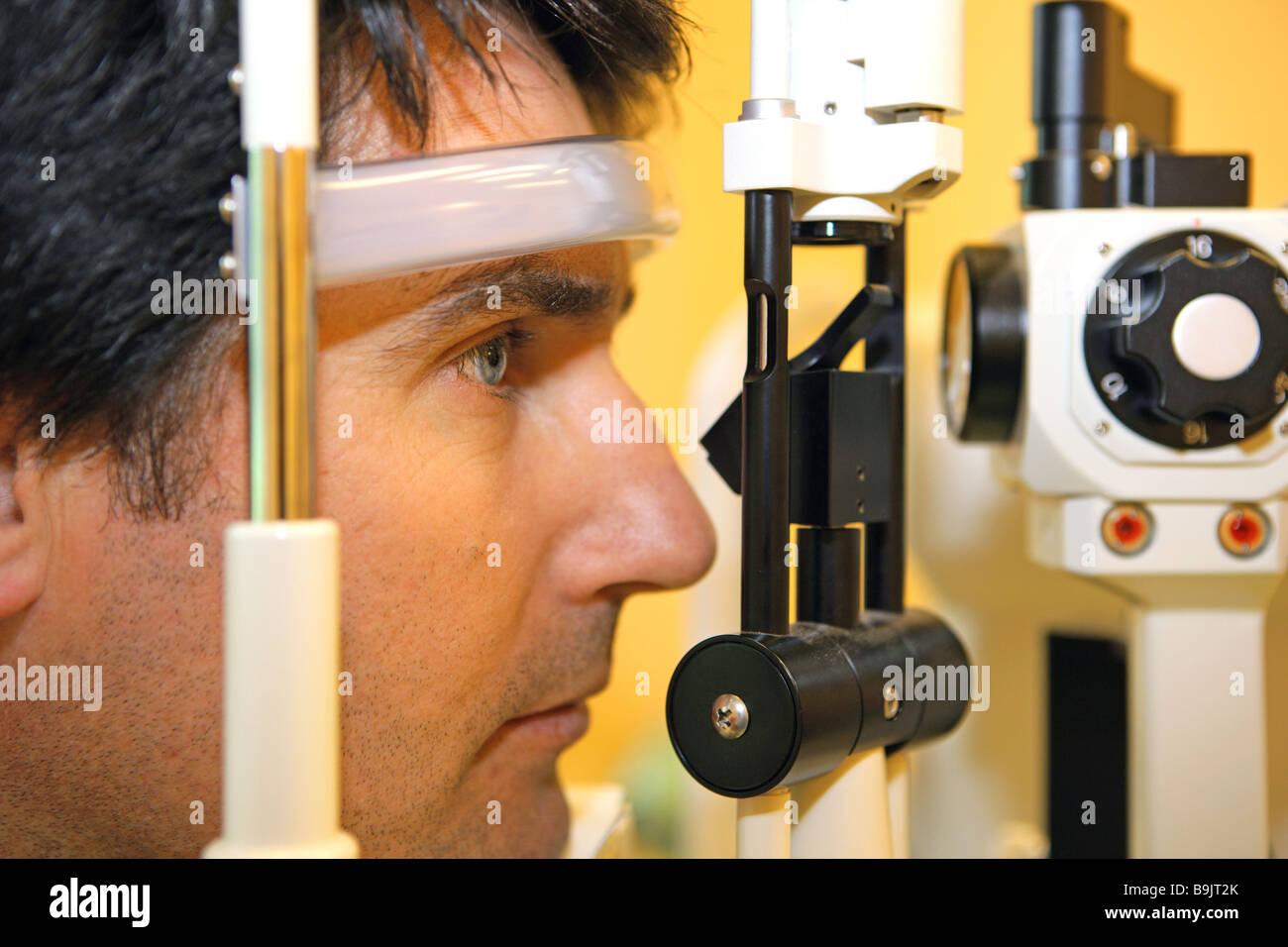 Man eye-diagnosis  Doctor's office eye eyes eye specialist eye-diagnosis optometry eye-examination ophthalmologic - Stock Image