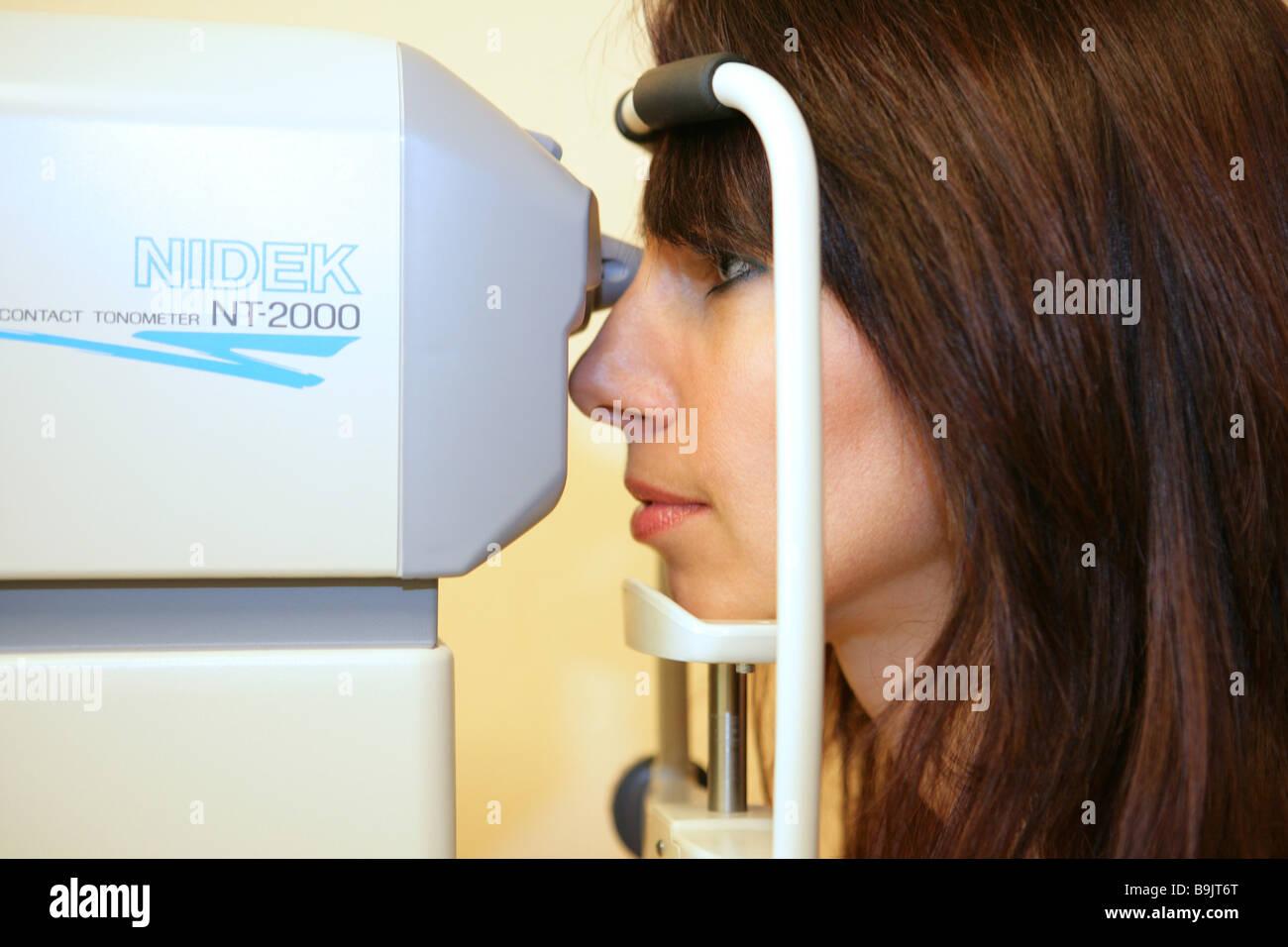 Woman eye-diagnosis  Doctor's office eye eyes eye specialist eye-diagnosis eye-pressure optometry eye-examination - Stock Image
