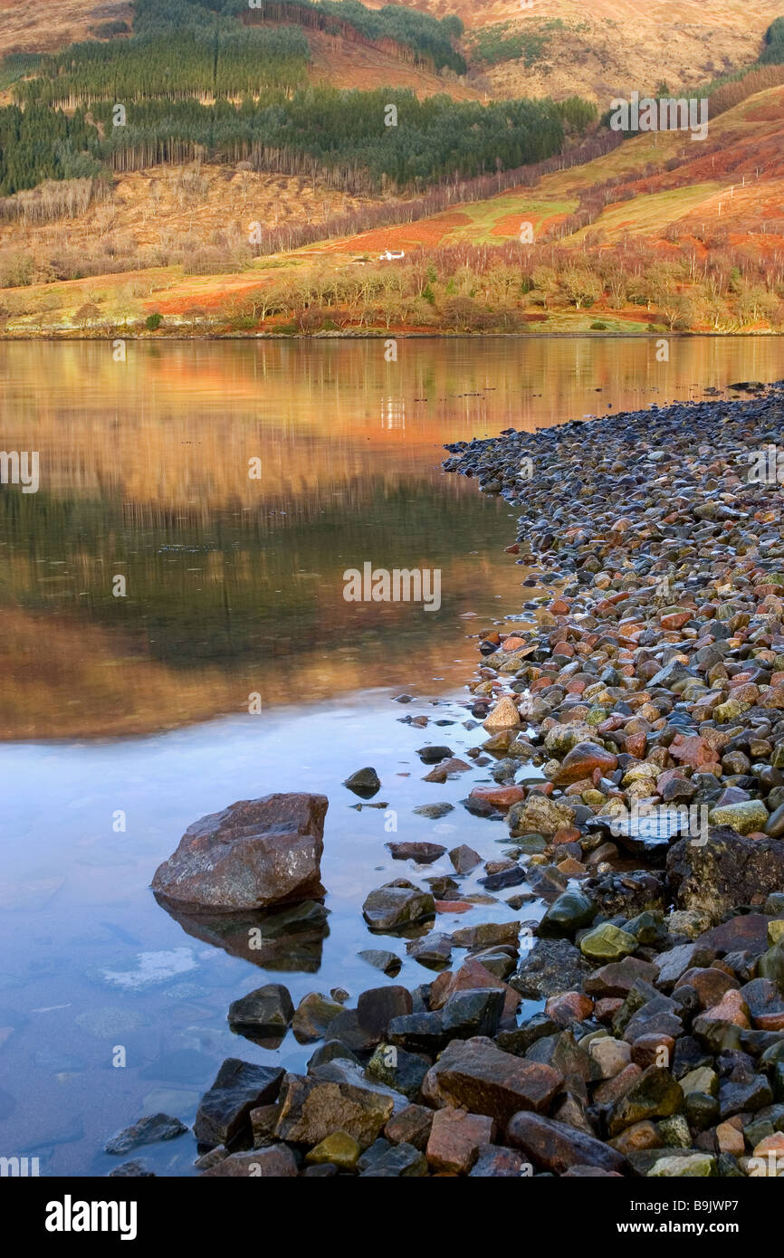 Reflections in Loch Leven at the village of Invercoe near Ballachulish, Glencoe, Argyll, Highlands, Scotland - Stock Image