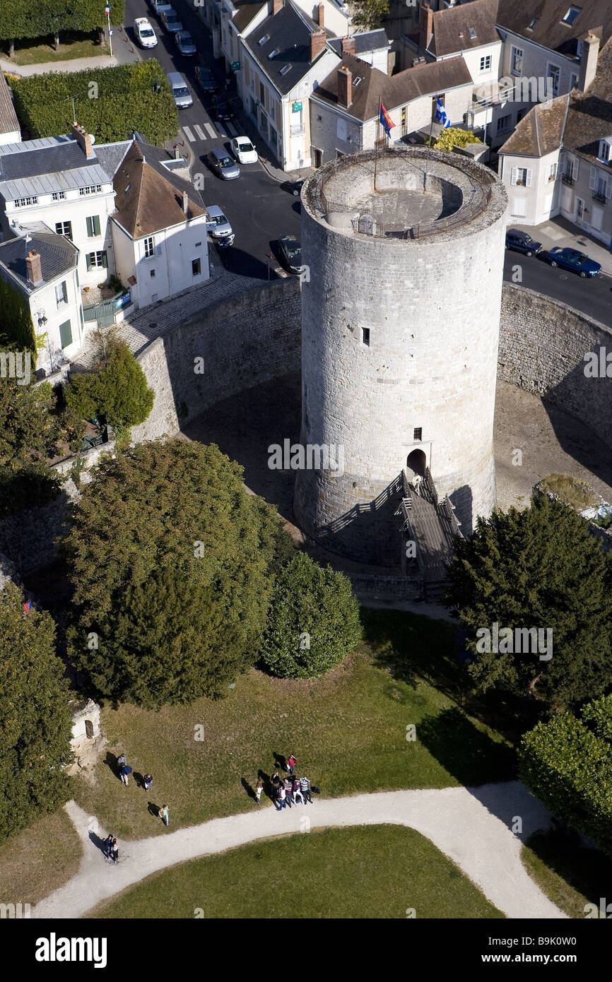 France, Essonne, Chevreuse Valley, Dourdan, donjon of the feudal castle (aerial view) Stock Photo