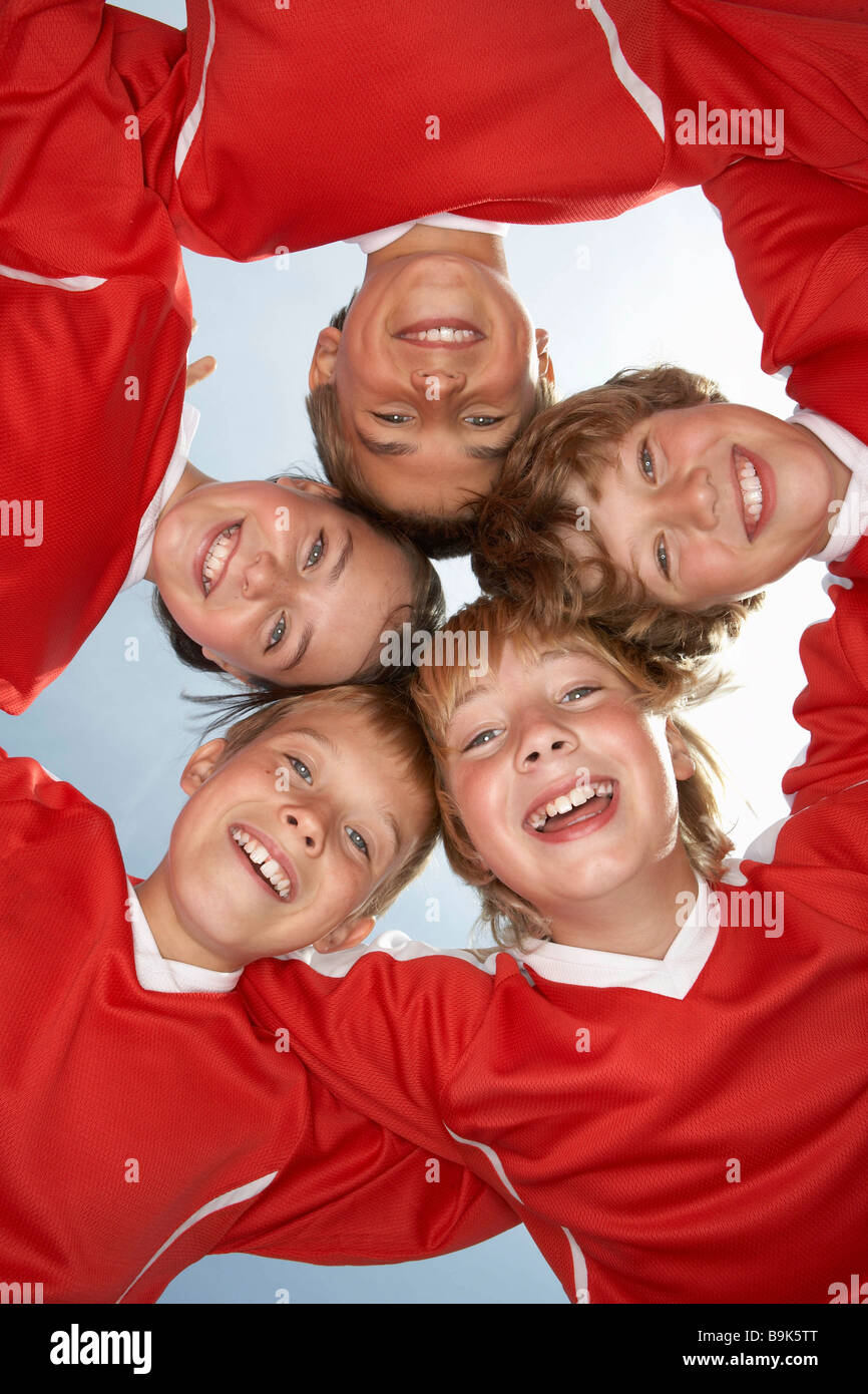 Low viewpoint of young football team - Stock Image