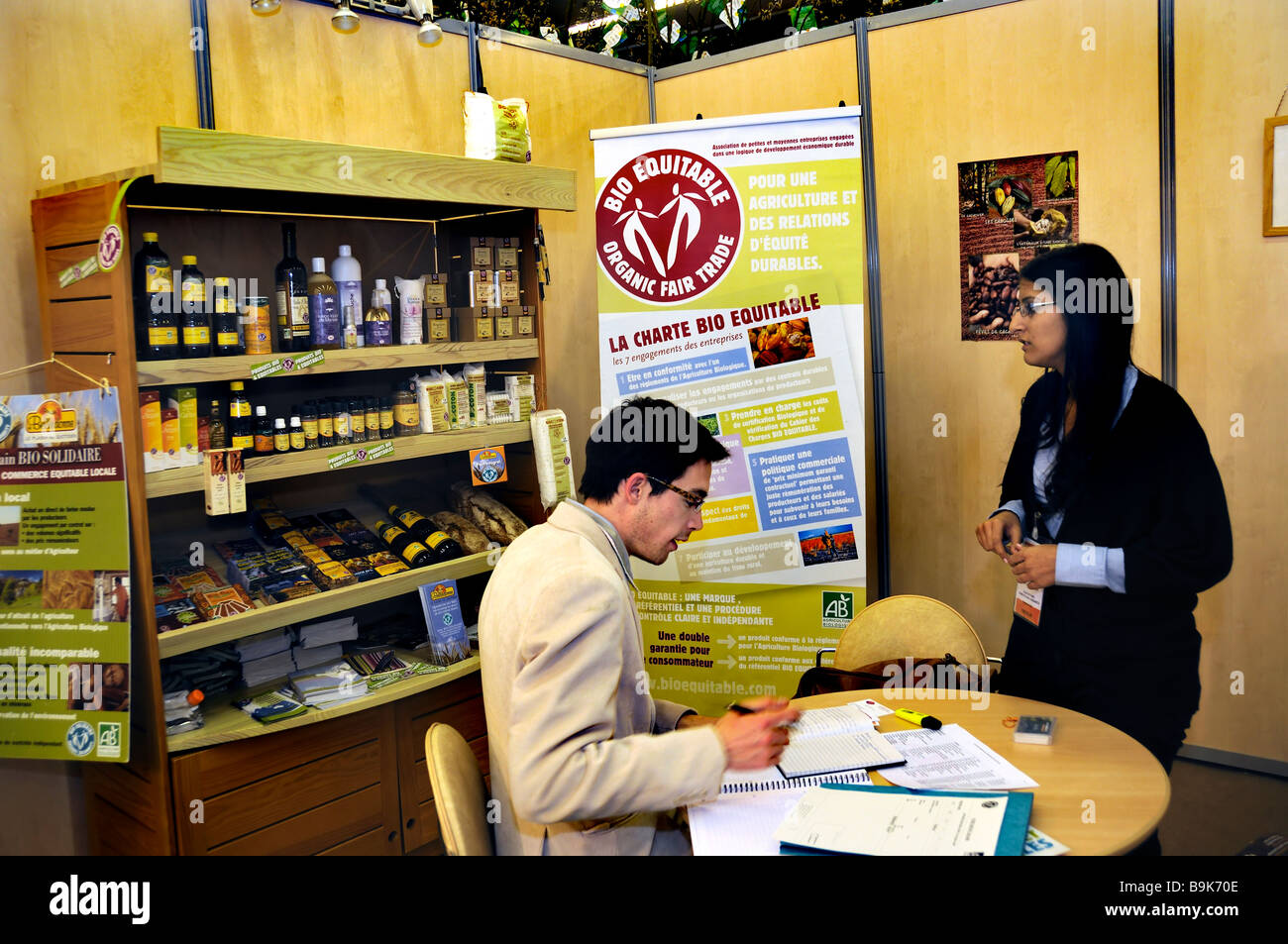PARIS, FRANCE, Woman Speaking with Man at Organic Trade Show, Fair Trade of Group 'Equitable Commerce' Companies - Stock Image
