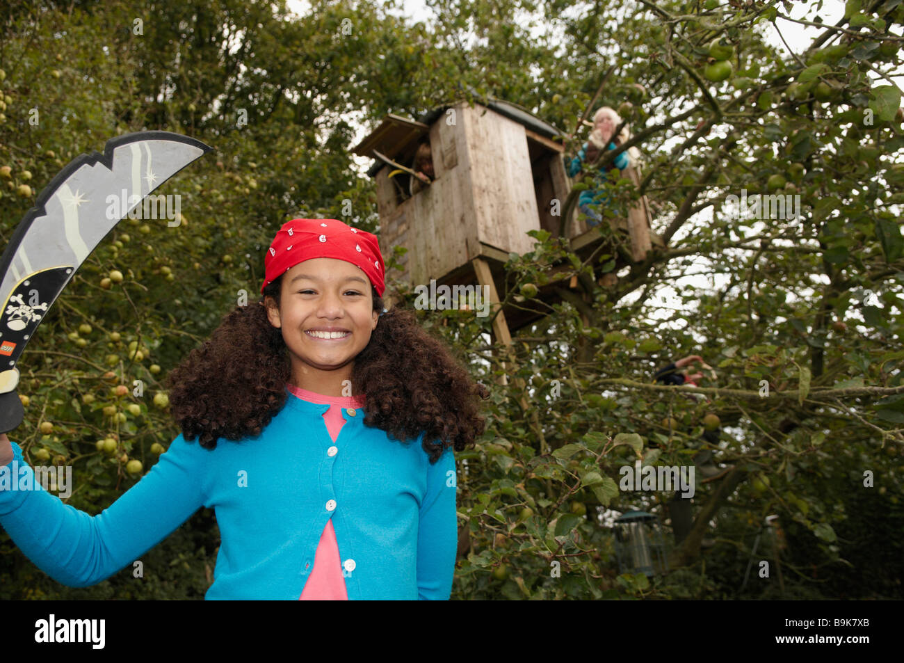 Children playing in treehouse - Stock Image
