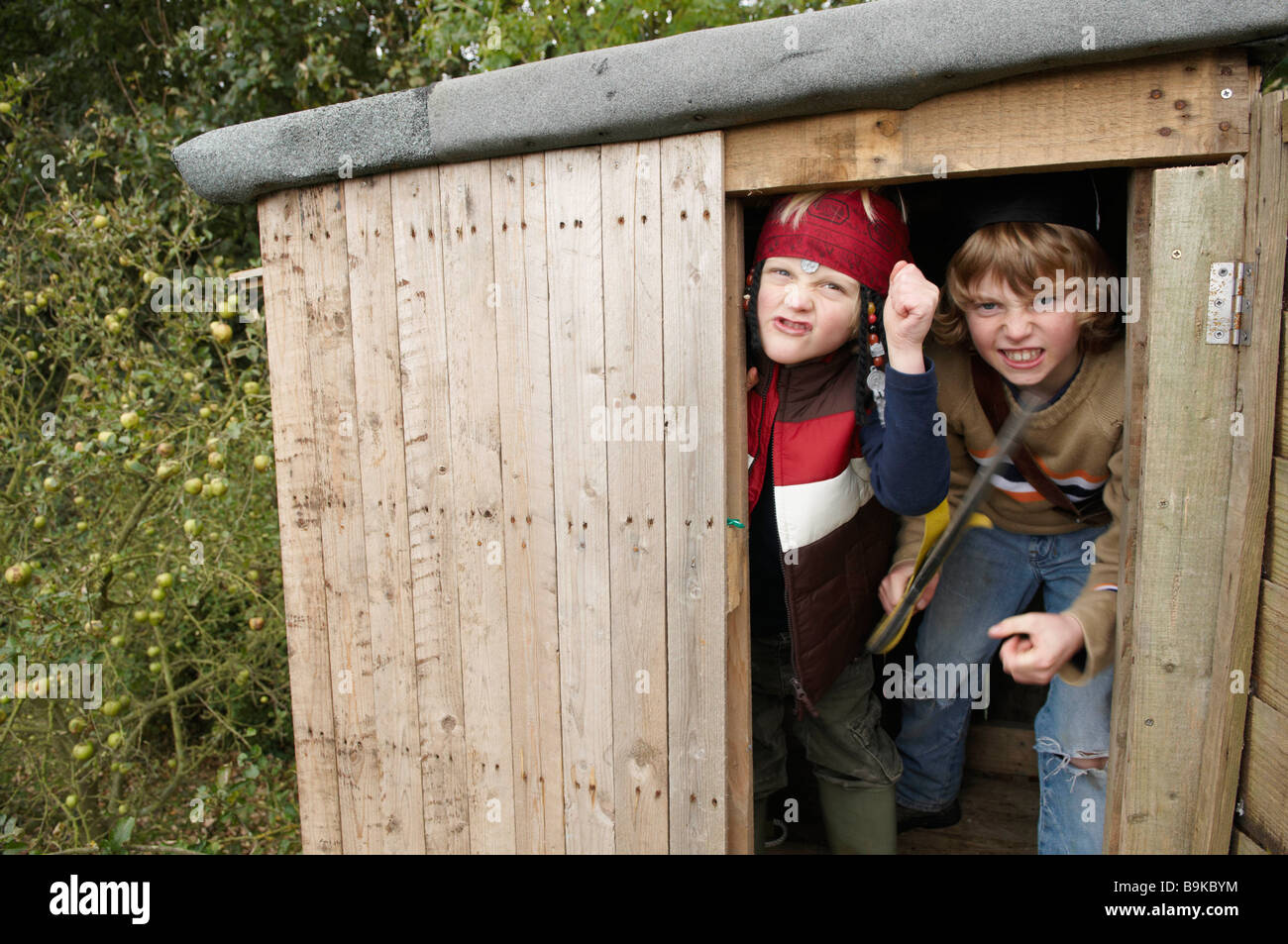 Young boys playing pirates - Stock Image