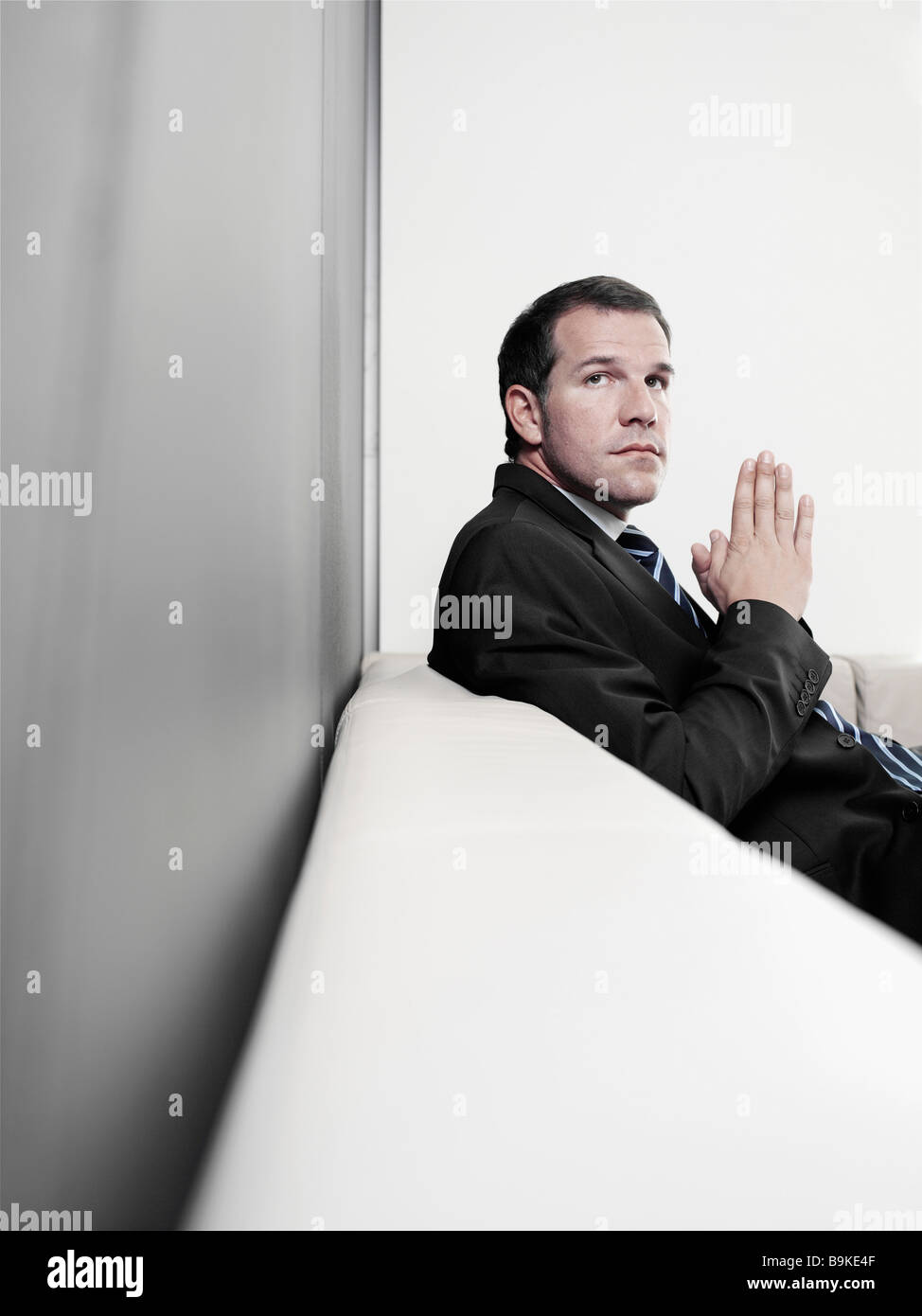 portrait of insecure looking businessman - Stock Image
