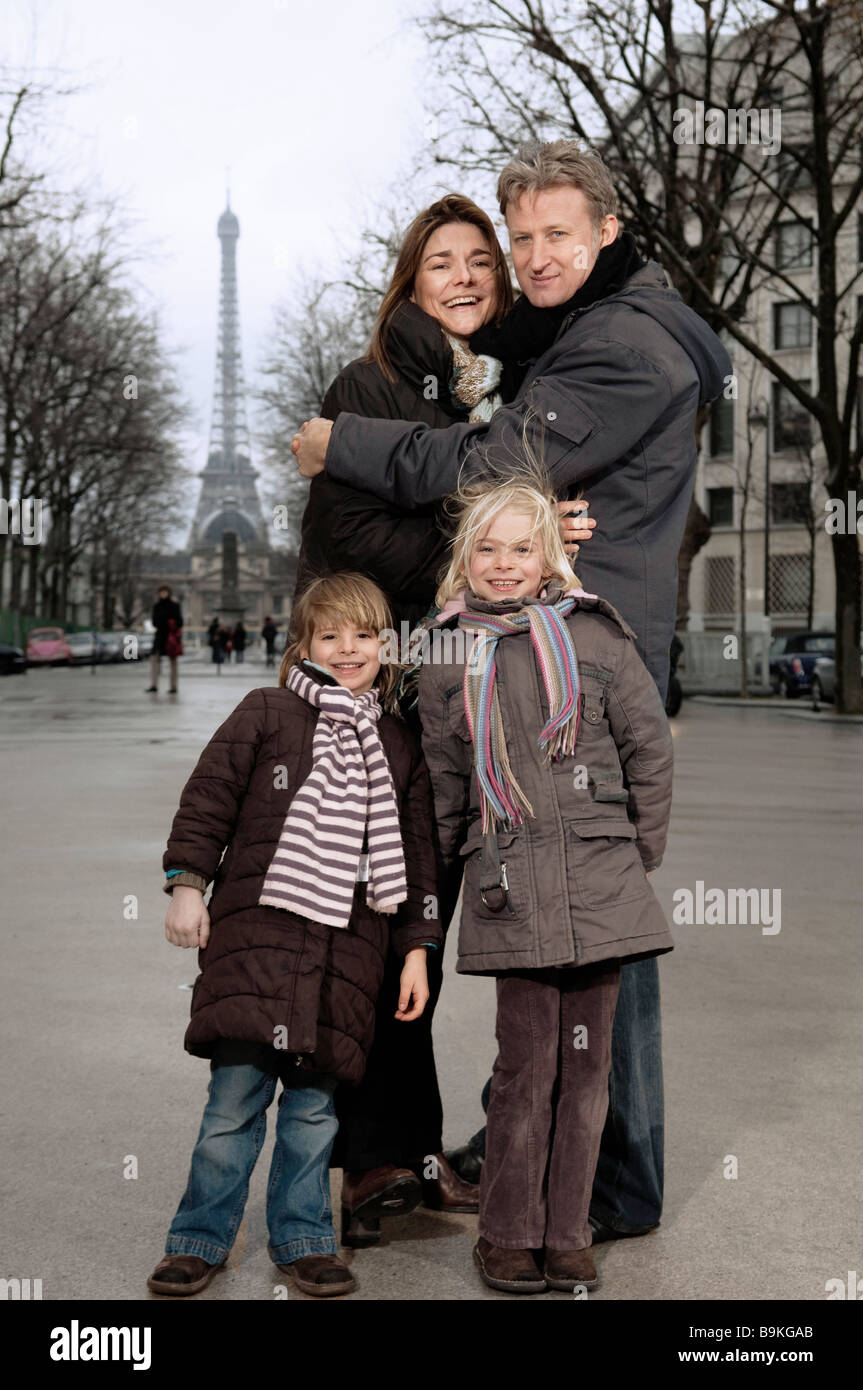 Family portrait with Eiffel Tower - Stock Image