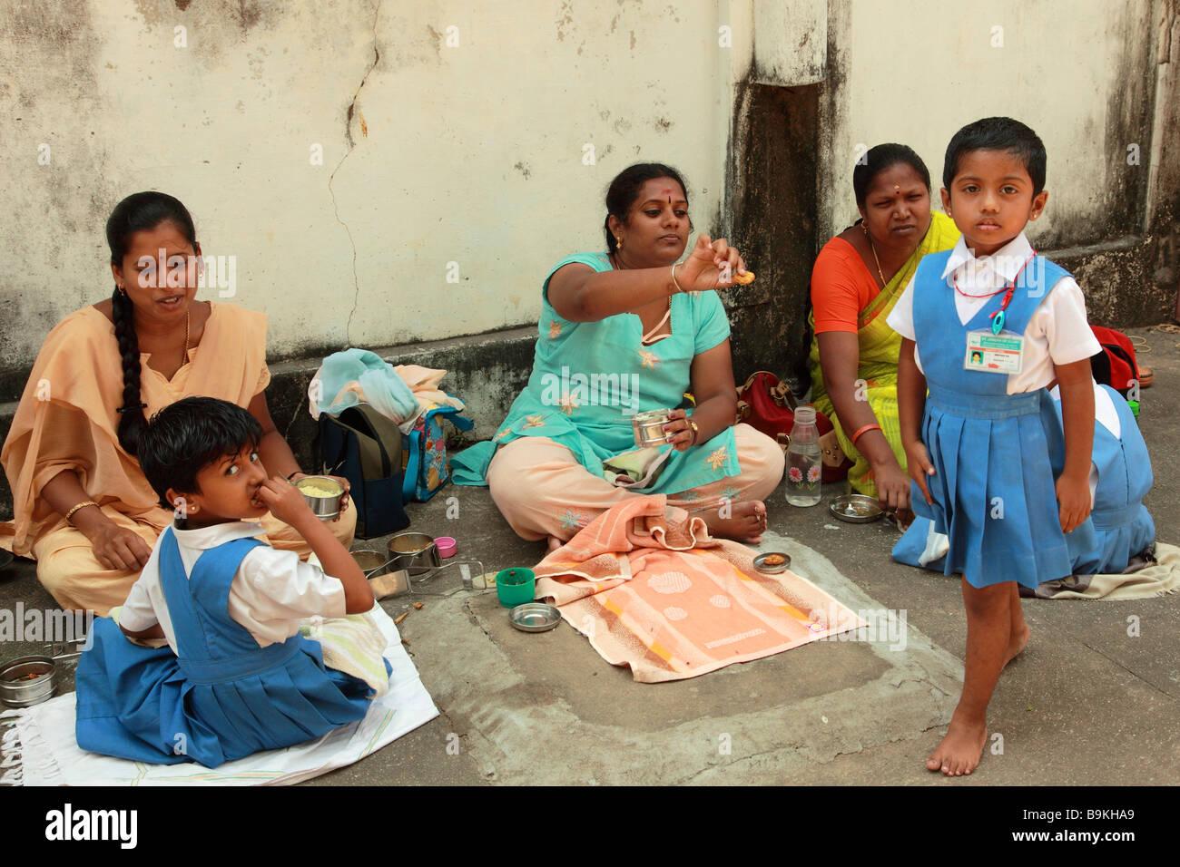 India Puducherry Pondicherry mothers with schoolchildren at lunch - Stock Image