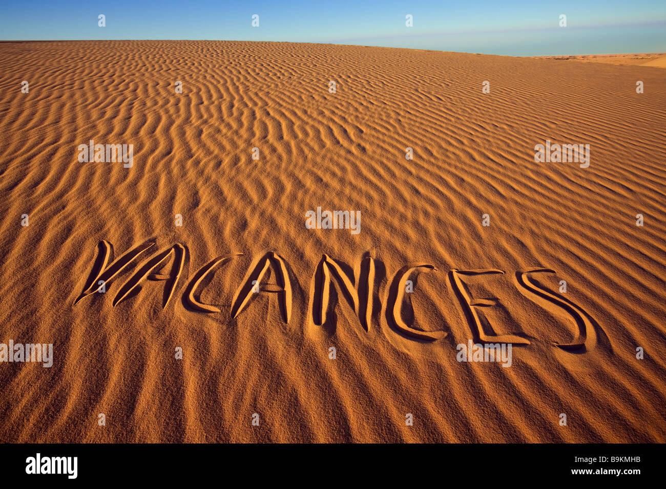 Mauritania, Adrar, Holidays written in the sand - Stock Image
