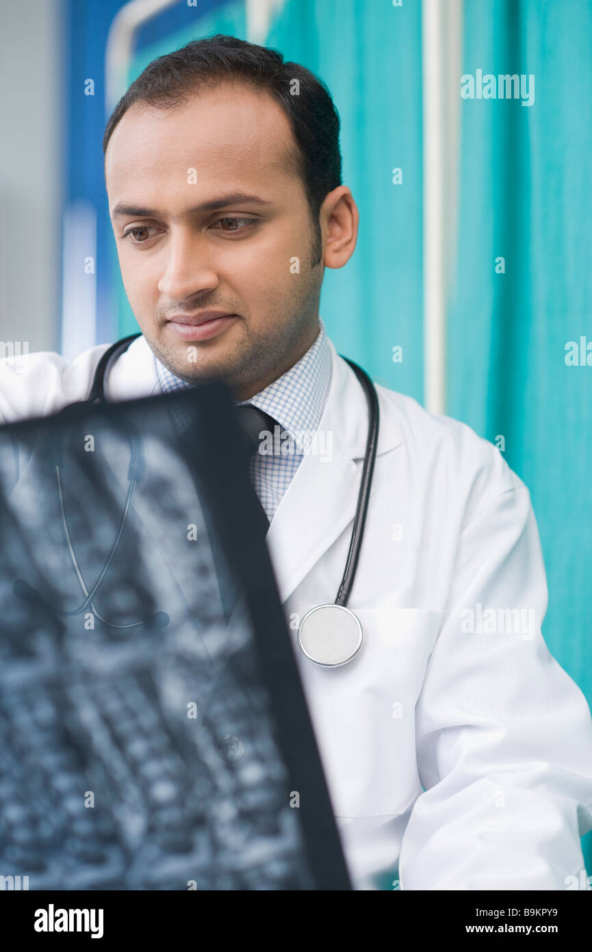 Doctor examining an x-ray report - Stock Image