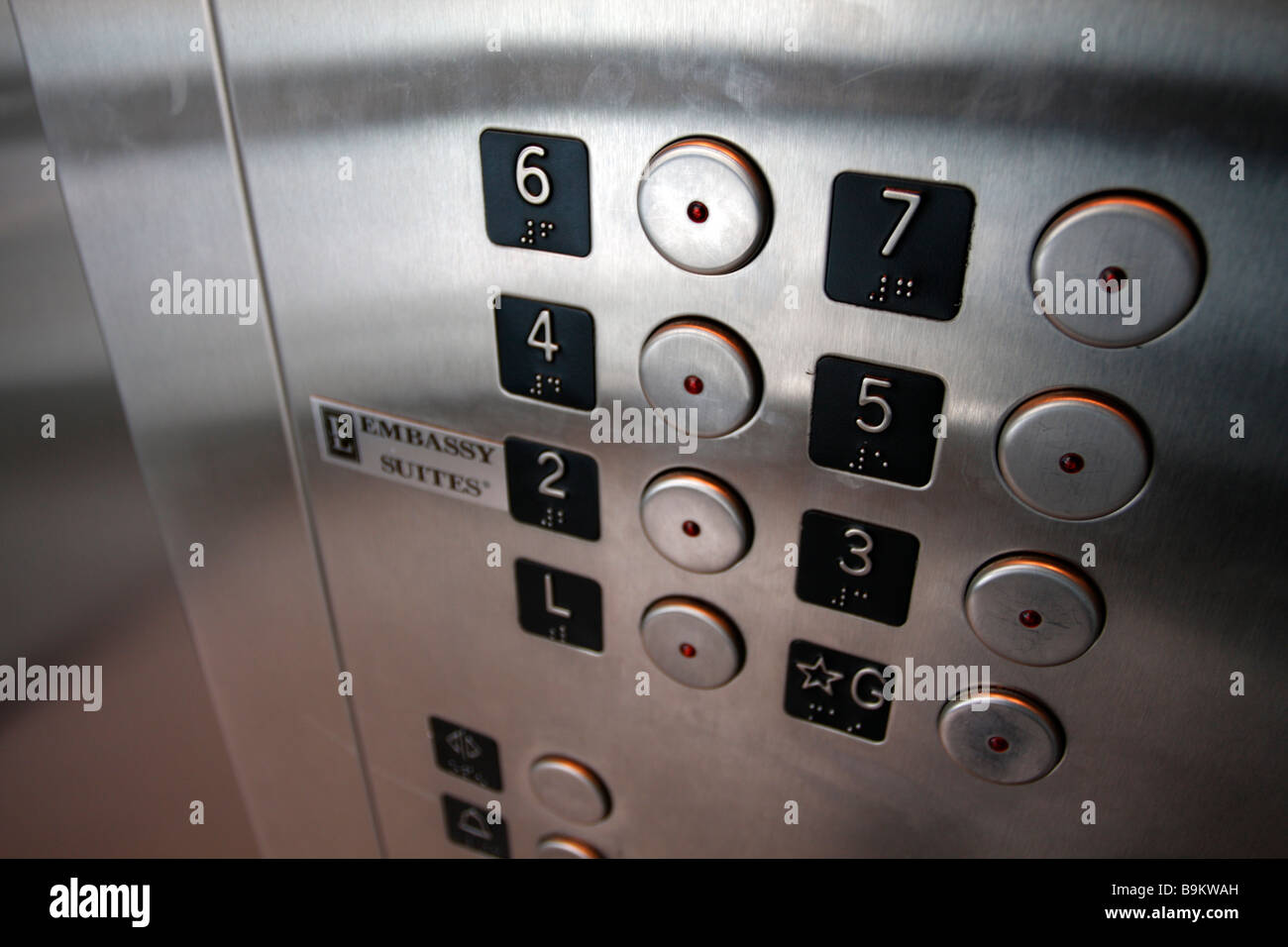 Elevator buttons panel stainless steel Embassy Suites logo - Stock Image