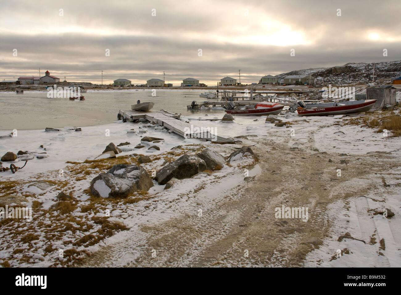 Boats in harbour at Taloyoak inuit settlement Nunavut, sunset, Canadian arctic, Canada - Stock Image