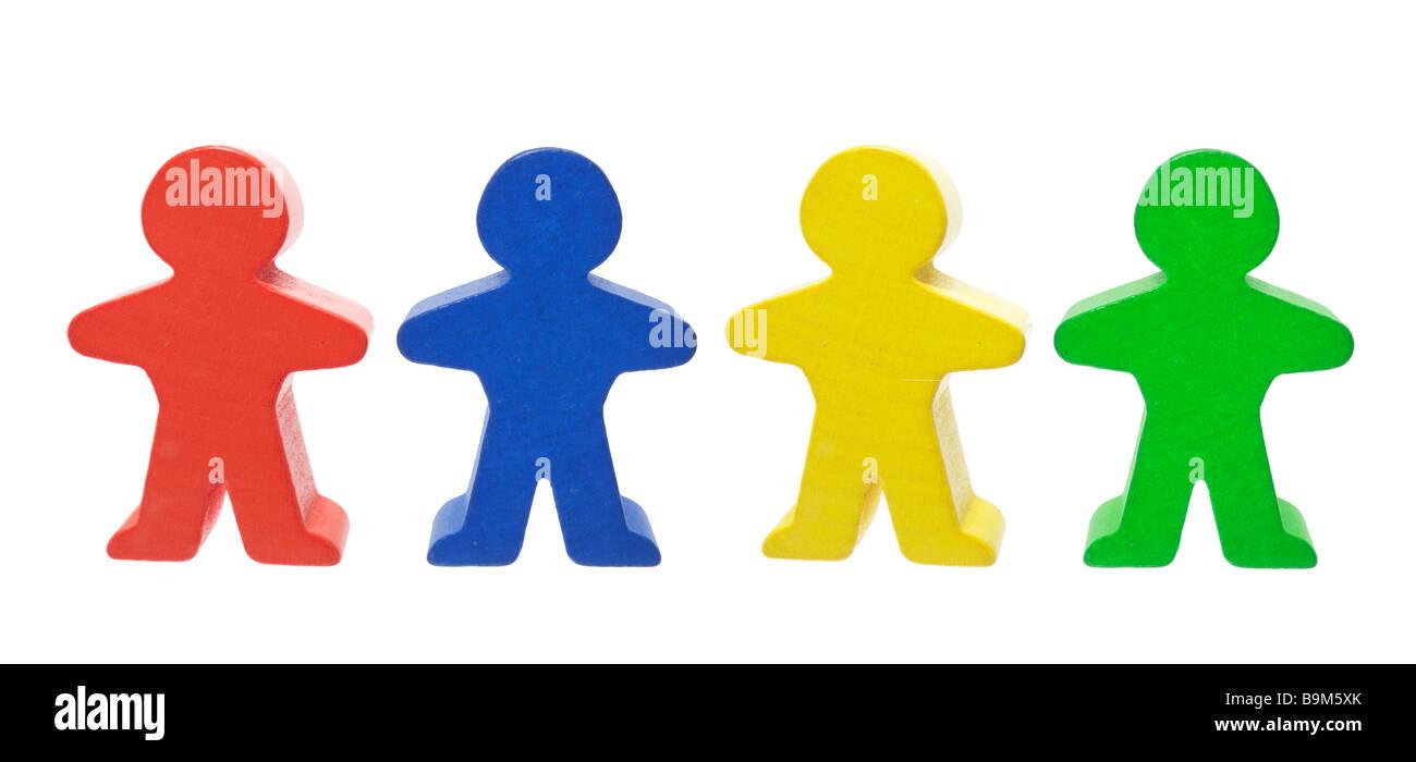Row of Wooden Figures - Stock Image