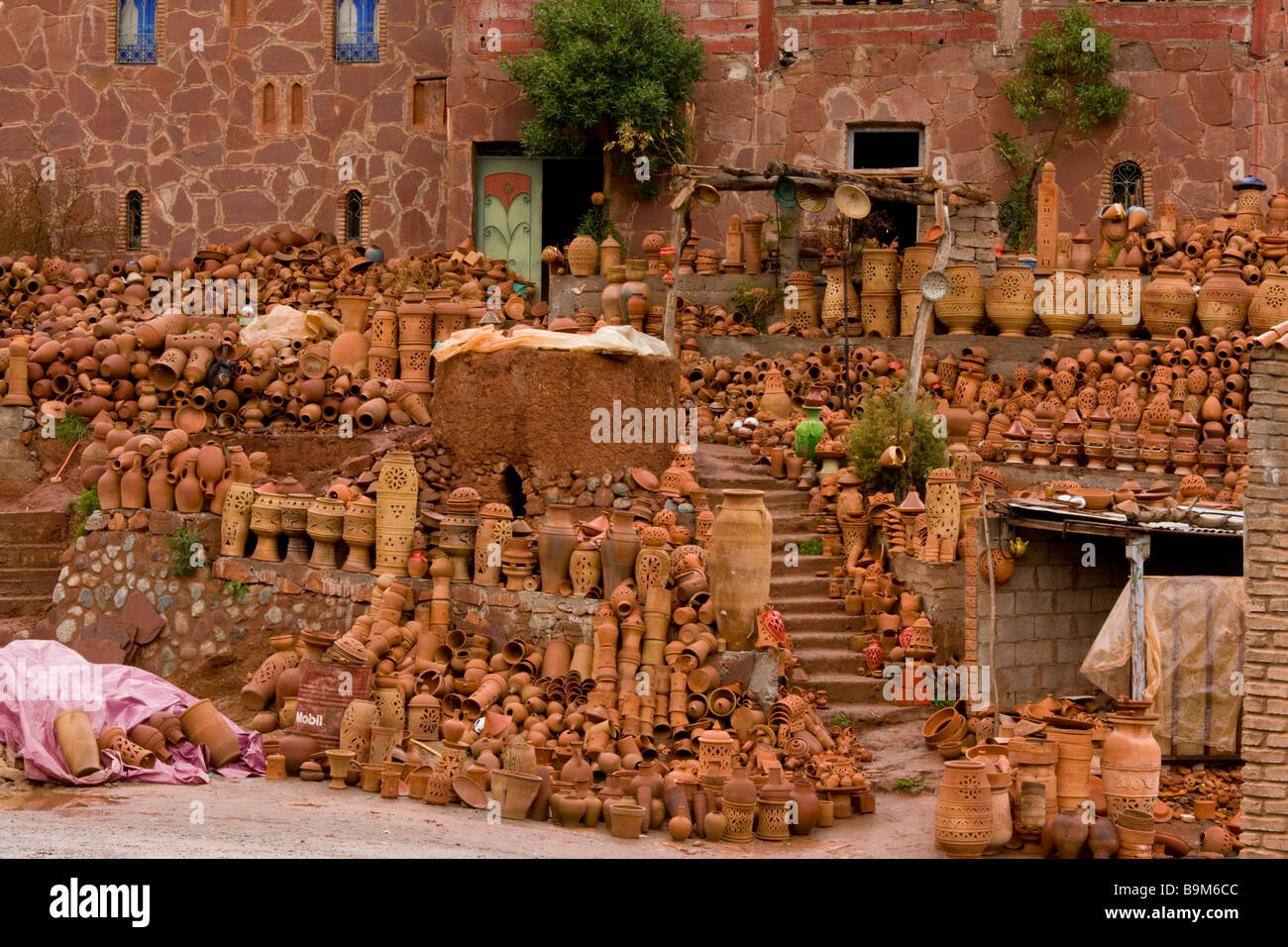 Extraordinary pottery display by roadside in Ourika Valley high Atlas mountains Morocco Morocco - Stock Image