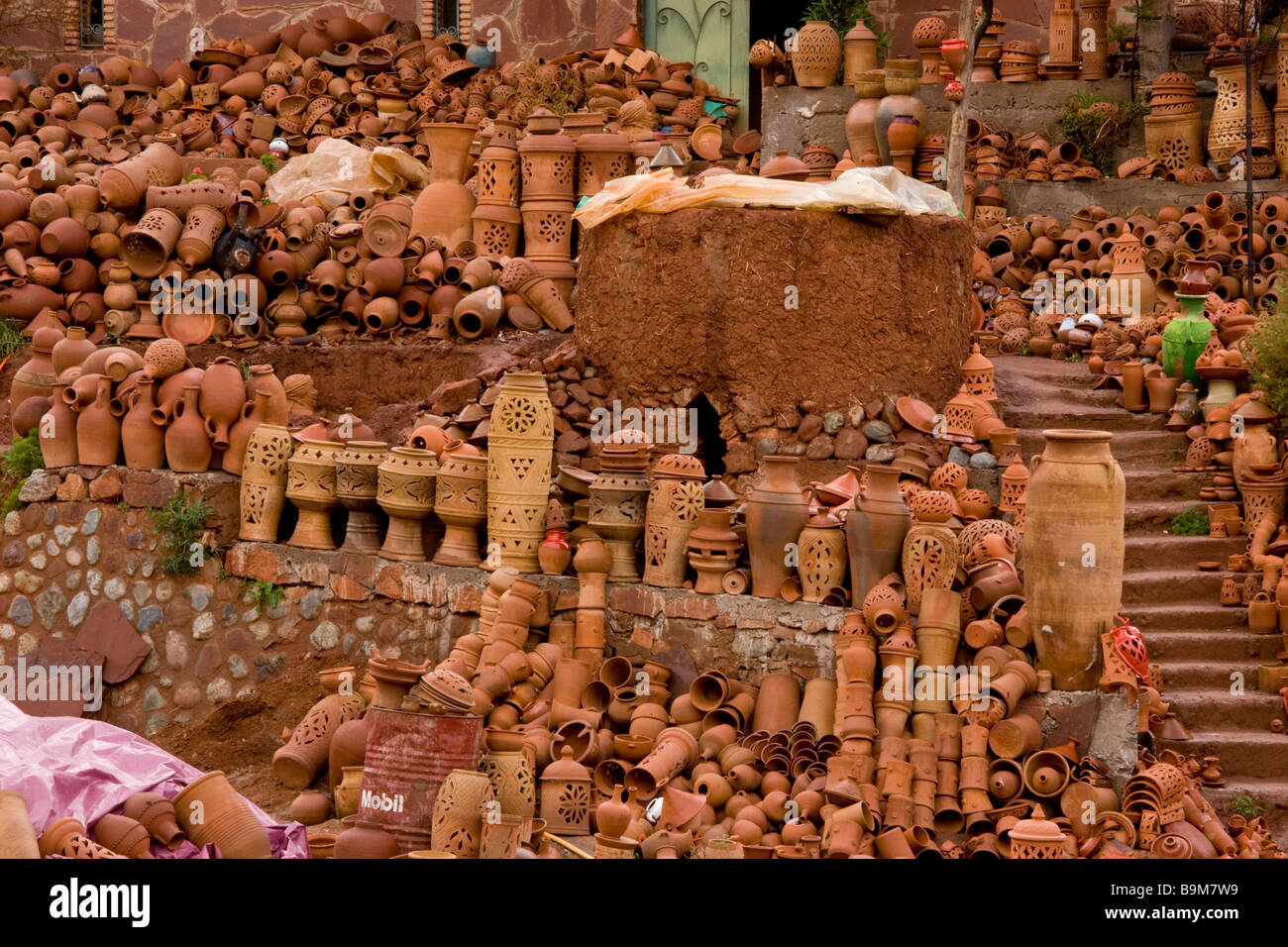 Extraordinary pottery display by roadside in Ourika Valley high Atlas mountains Morocco - Stock Image