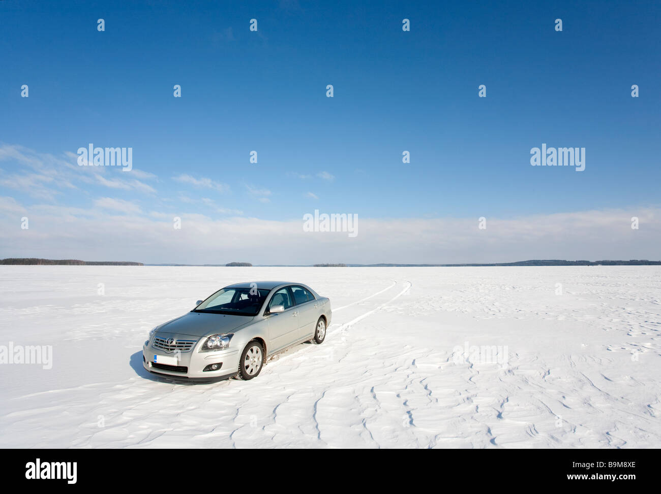 Toyota Avensis 2007 on lake Keitele ice , Finland - Stock Image