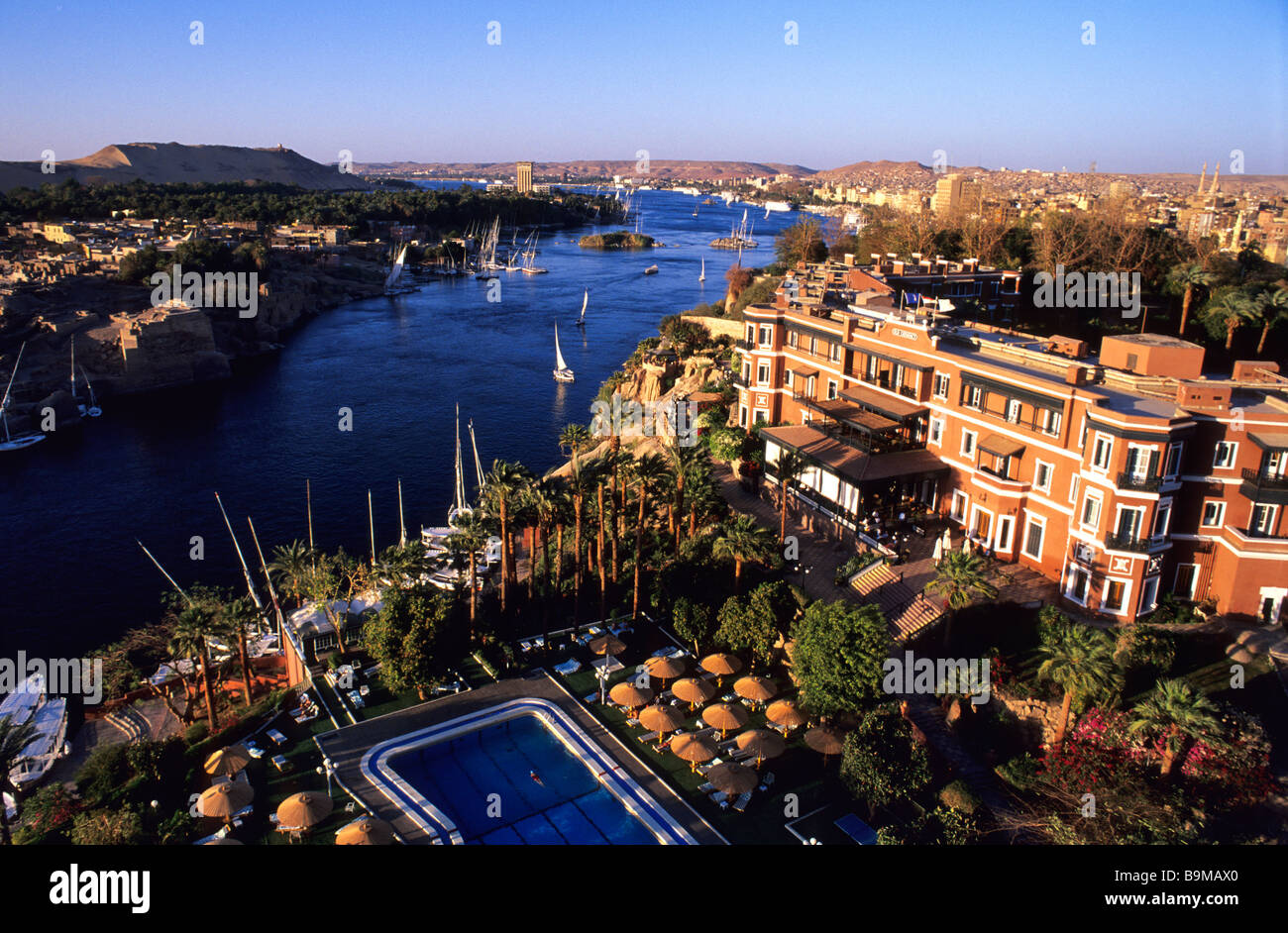 Egypt, Upper Egypt, Nubia, Aswan, Feluccas on the Nile river and Old Cataract Hotel - Stock Image