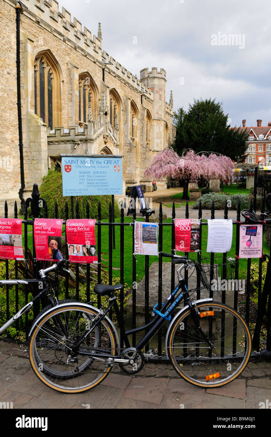 Bicycles chained up by Great St Marys church, Cambridge England Uk - Stock Image