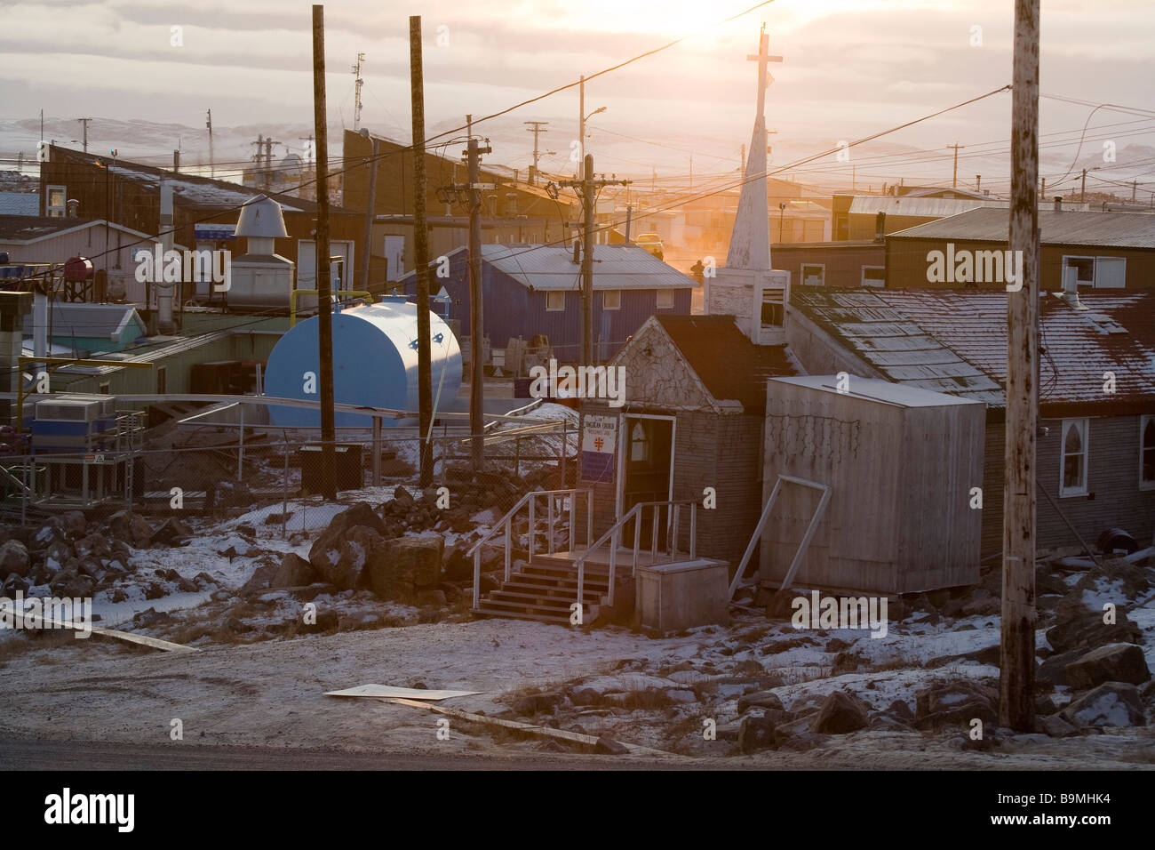 Traditional buildings at sunset in Taloyoak inuit settlement Nunavut, elevated view, Canadian arctic, Canada - Stock Image