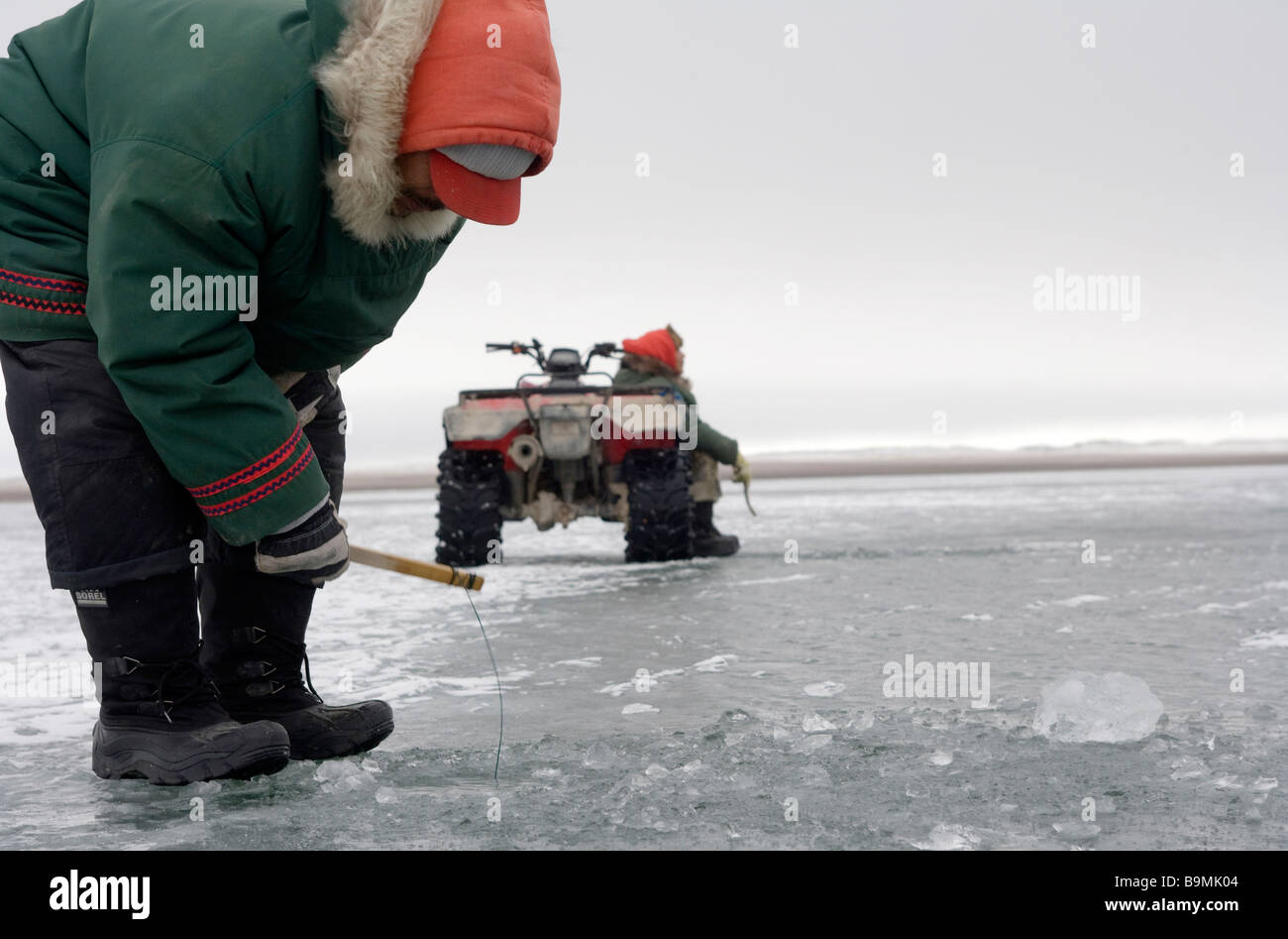Canadian Rangers fishing on sea ice, Canadian Arctic, Canada - Stock Image