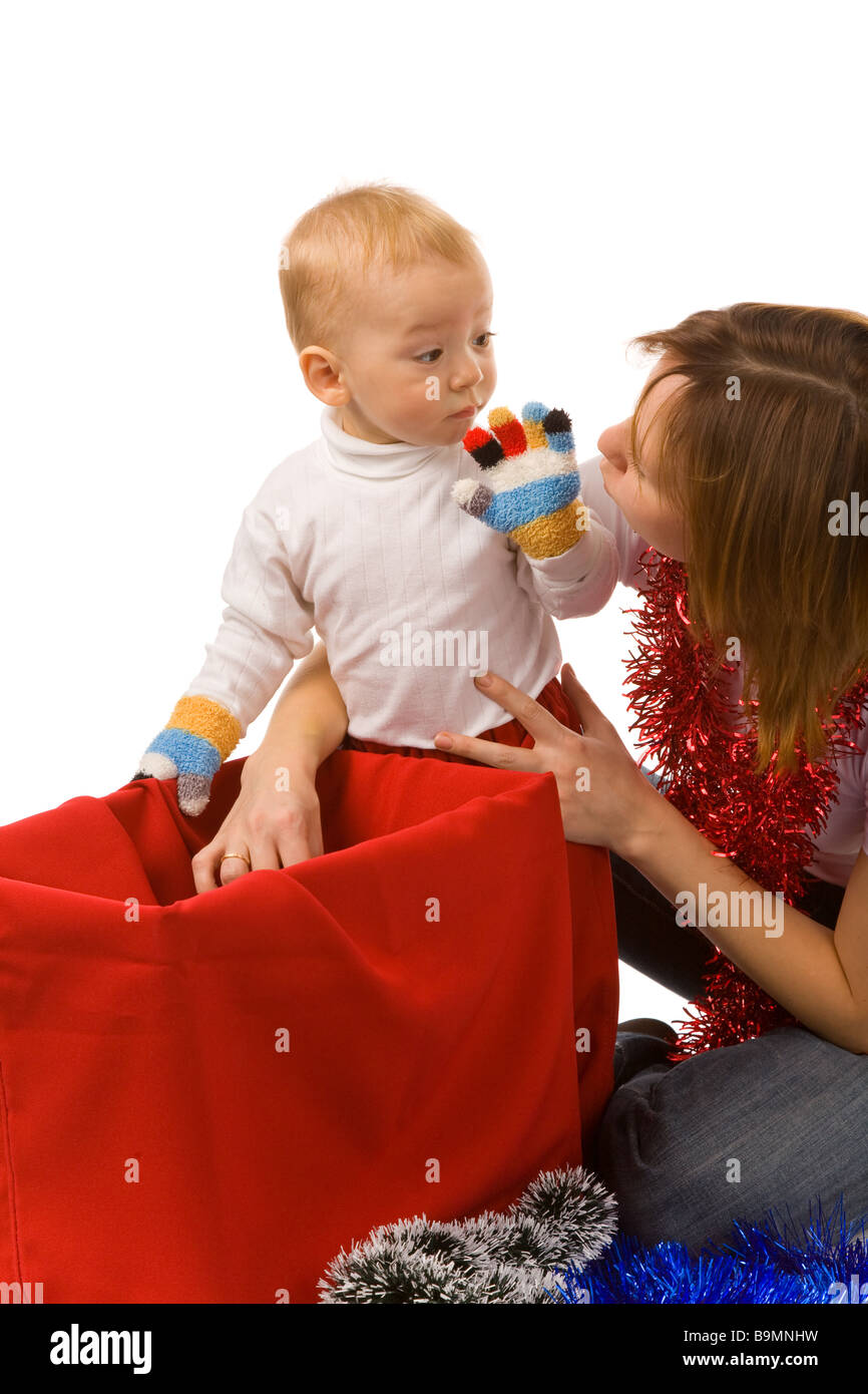 Mum with the son search for gifts in a red bag - Stock Image